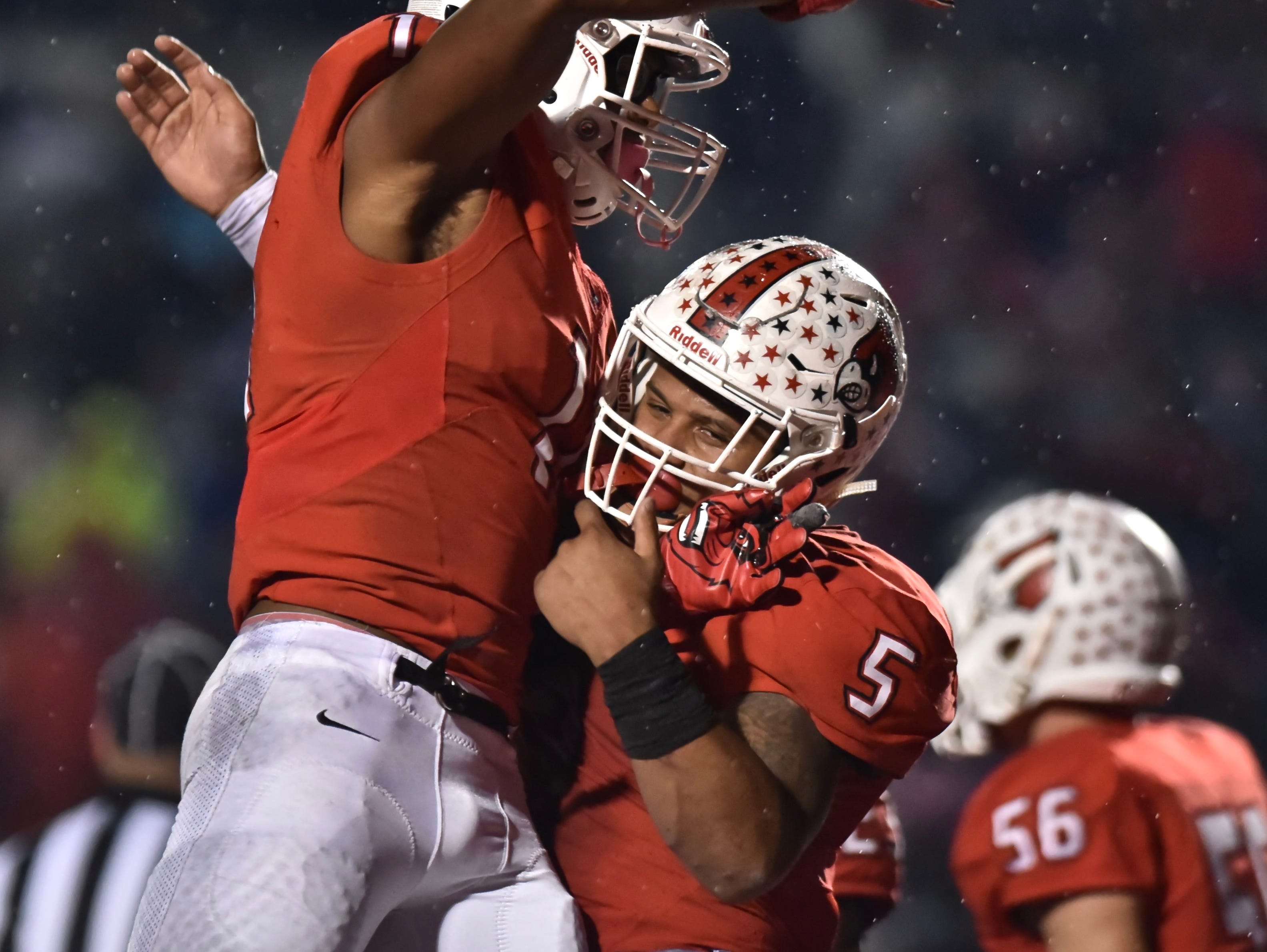 Colerain's Elijah Ford and Ivan Pace Jr. celebrate against Fairfield Friday, Oct. 19, 2018 at Colerain High School
