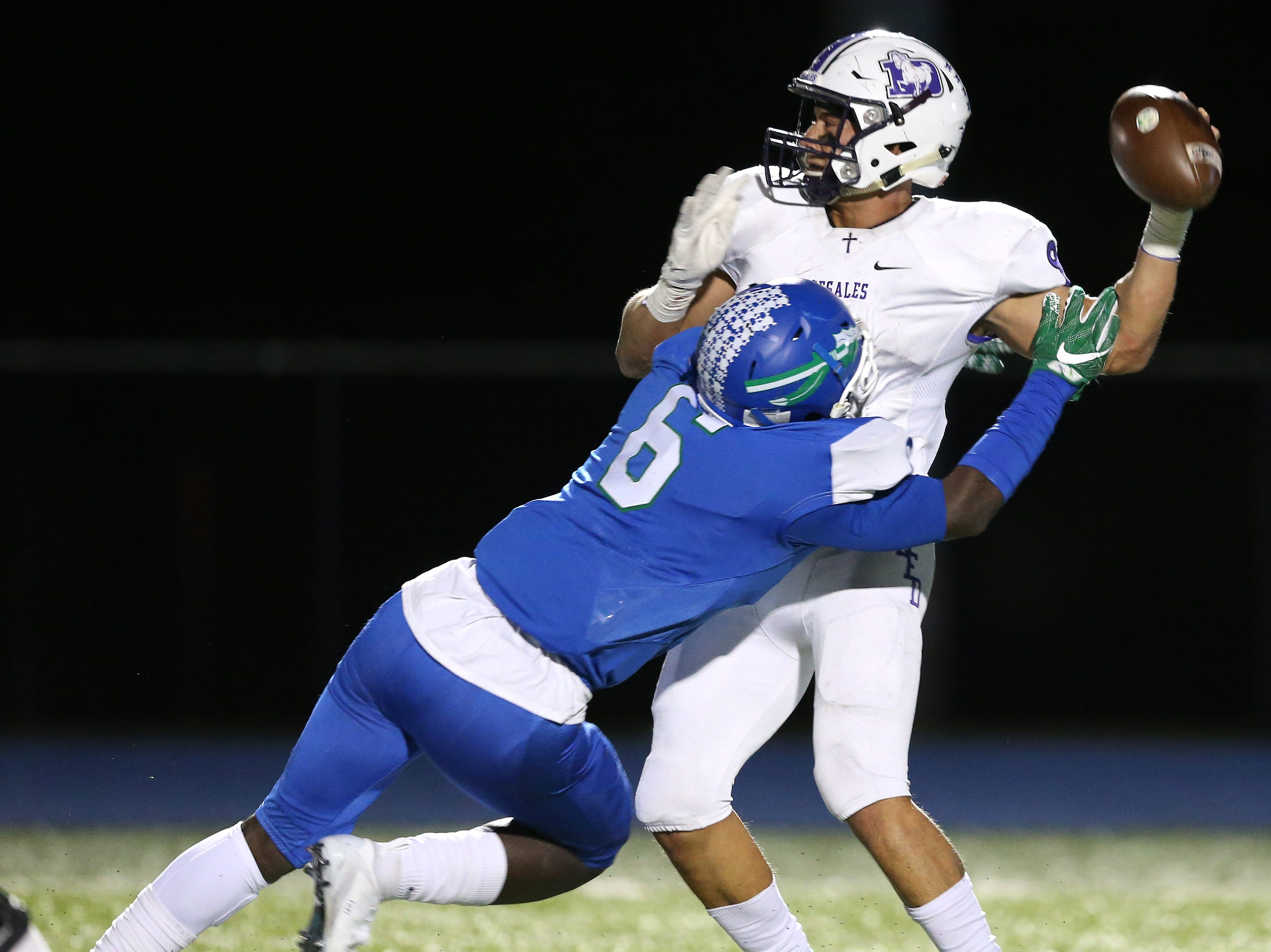 Winton Woods Warriors linebacker Waseem Ficklin (6) pressures St. Francis de Sales Stallions quarterback Joey Velazquez (9) in the second quarter during a high school football game between St. Francis de Sales and Winton Woods, Friday, Oct. 19, 2018, at Winton Woods High School in Forest Park, Ohio.