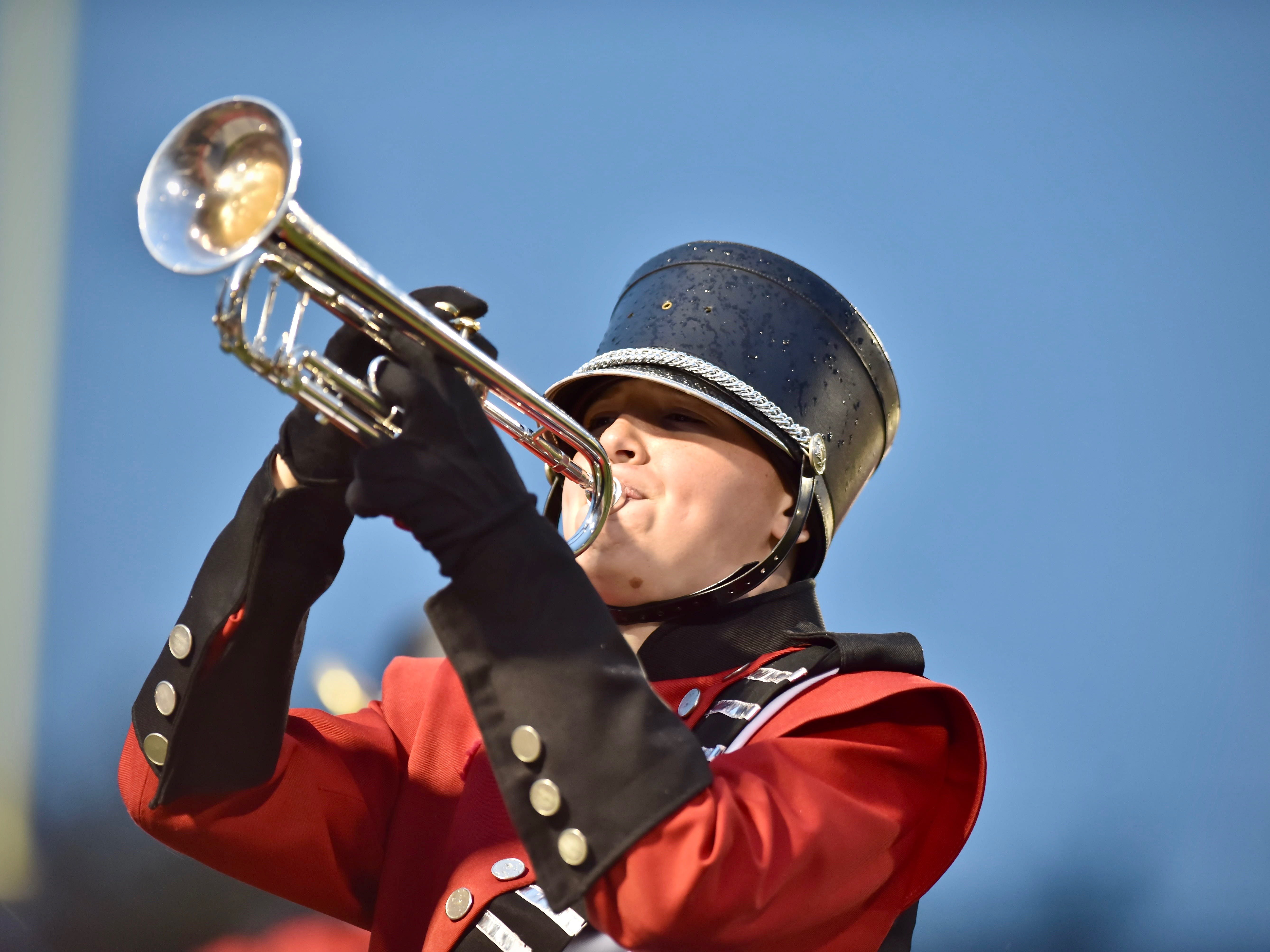 A member of the Colerain marching band performs during the National Anthem Friday, Oct. 19, 2018 at Colerain High School