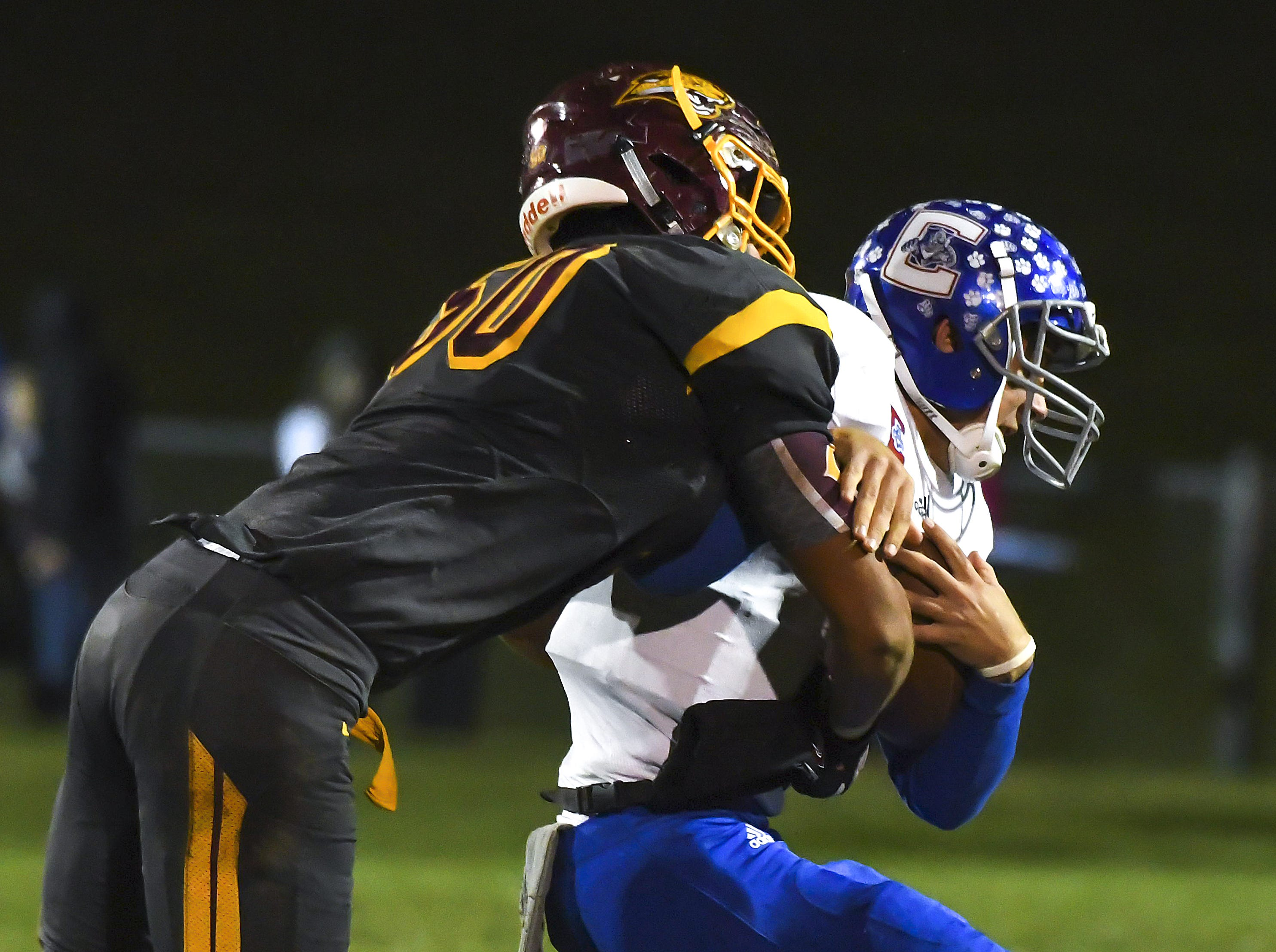 Cooper defender Michael Attabary sacks Conner quarterback Jared Hicks in the Skyline Chili Crosstown Showdown at Cooper High School, Union, KY, Friday Oct. 19, 2018