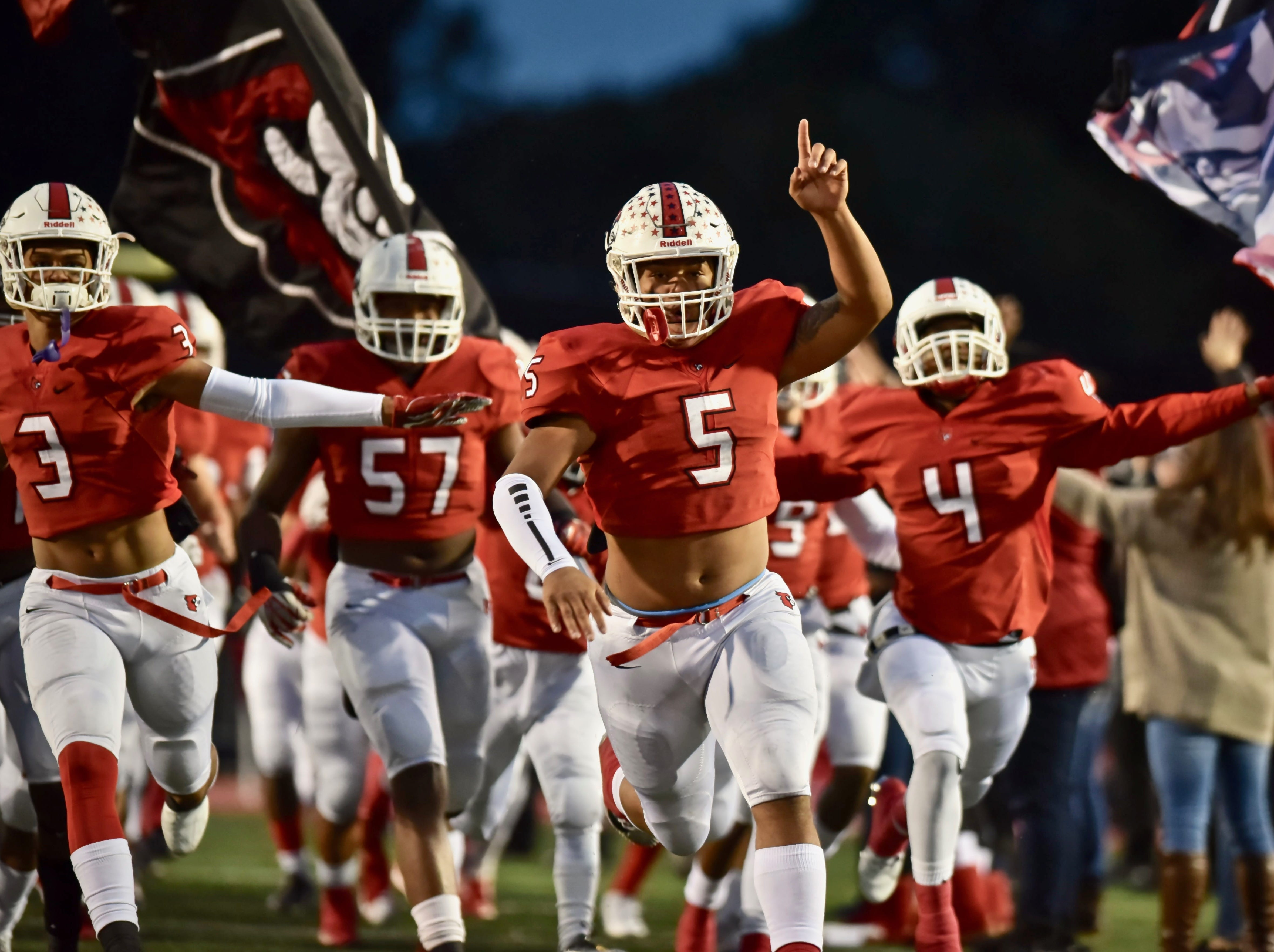 The Colerain Cardinals take the field before their game against Fairfield Friday, Oct. 19, 2018 at Colerain High School