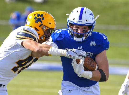 St. X receiver Drew Maier runs the ball against St. I's at St. Xavier High School, Saturday, October, 20 2018