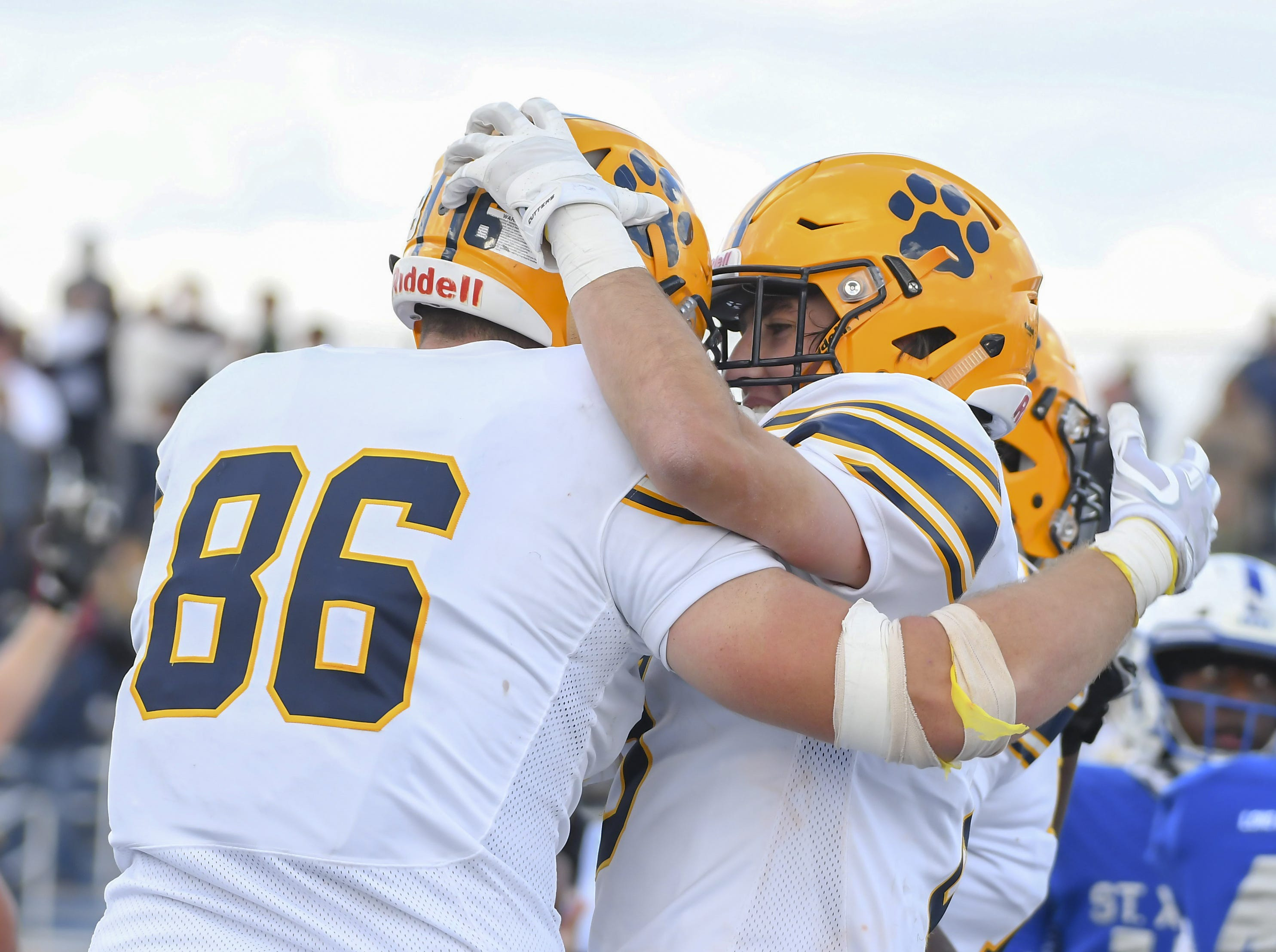 St. Ignatius tightend Aiden Wells (86) celebrates with a teammate against St. X at St. Xavier High School, Saturday, October, 20 2018