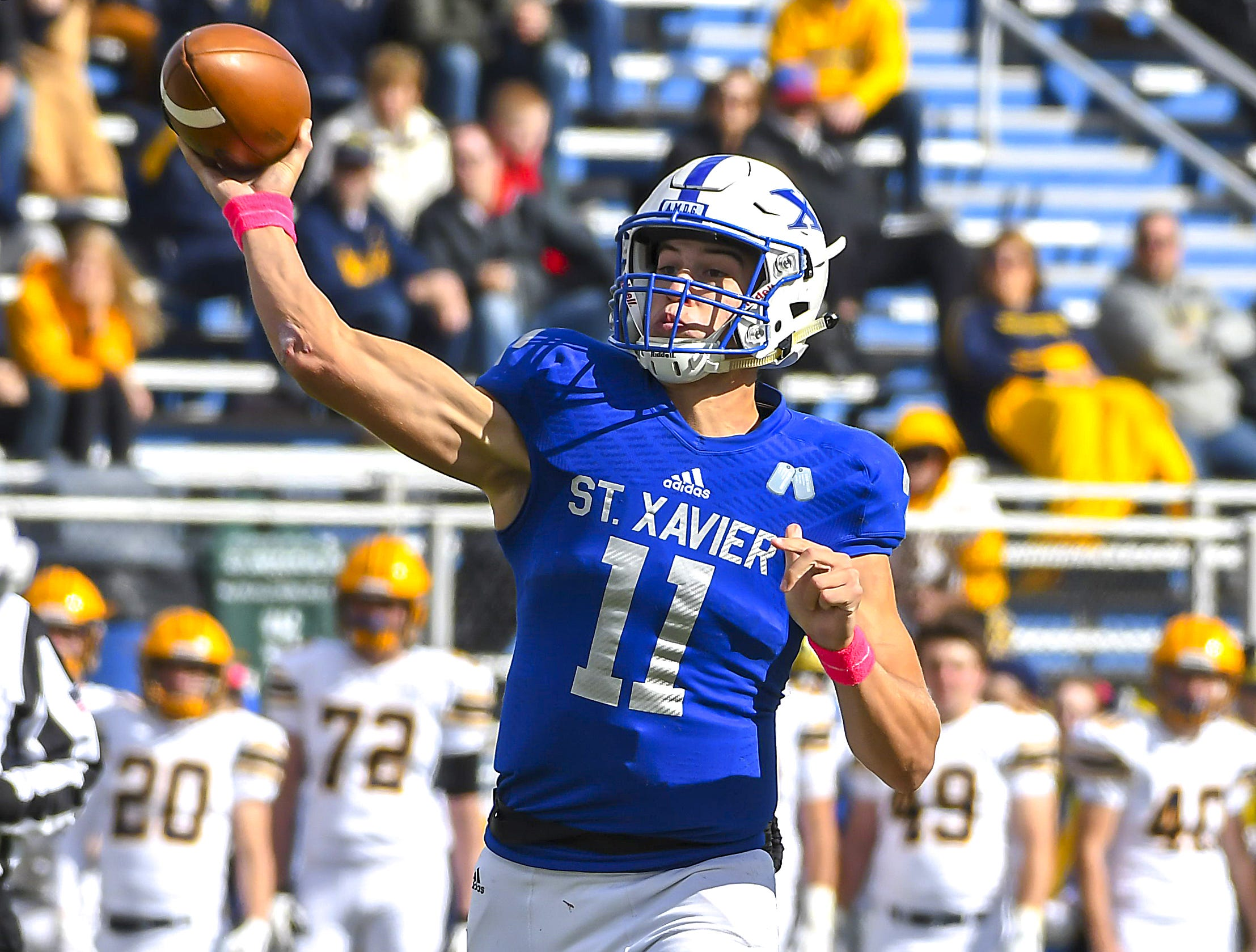 St. X quarterback Wyatt Hudepohl throws a touchdown pass against Cleveland St. Ignatius at St. Xavier High School, Saturday, October, 20 2018