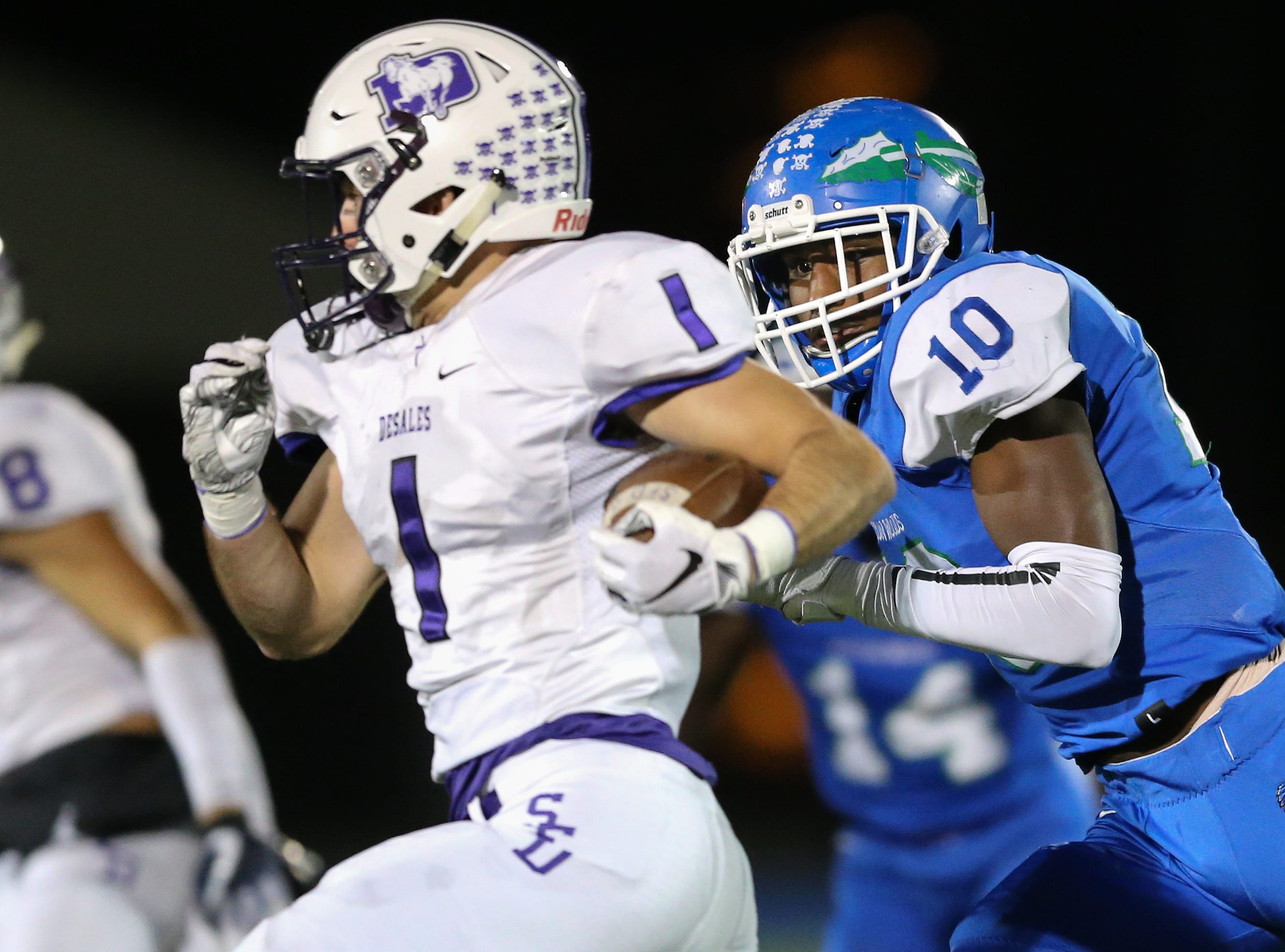 Winton Woods Warriors linebacker Melvin Pleasant (10) tracks St. Francis de Sales Stallions wide receiver Carter Hilleary (1) in the Second quarter during a high school football game between St. Francis de Sales and Winton Woods, Friday, Oct. 19, 2018, at Winton Woods High School in Forest Park, Ohio.