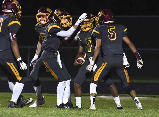 Cooper players celebrate after a touchdown against Conner in the Skyline Chili Crosstown Showdown at Cooper High School, Union, KY, Friday Oct. 19, 2018
