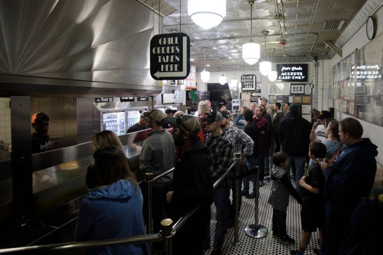 A line forms at Jim's Steaks South Street on Friday, Oct. 19, 2018, in Philadelphia, Penn.