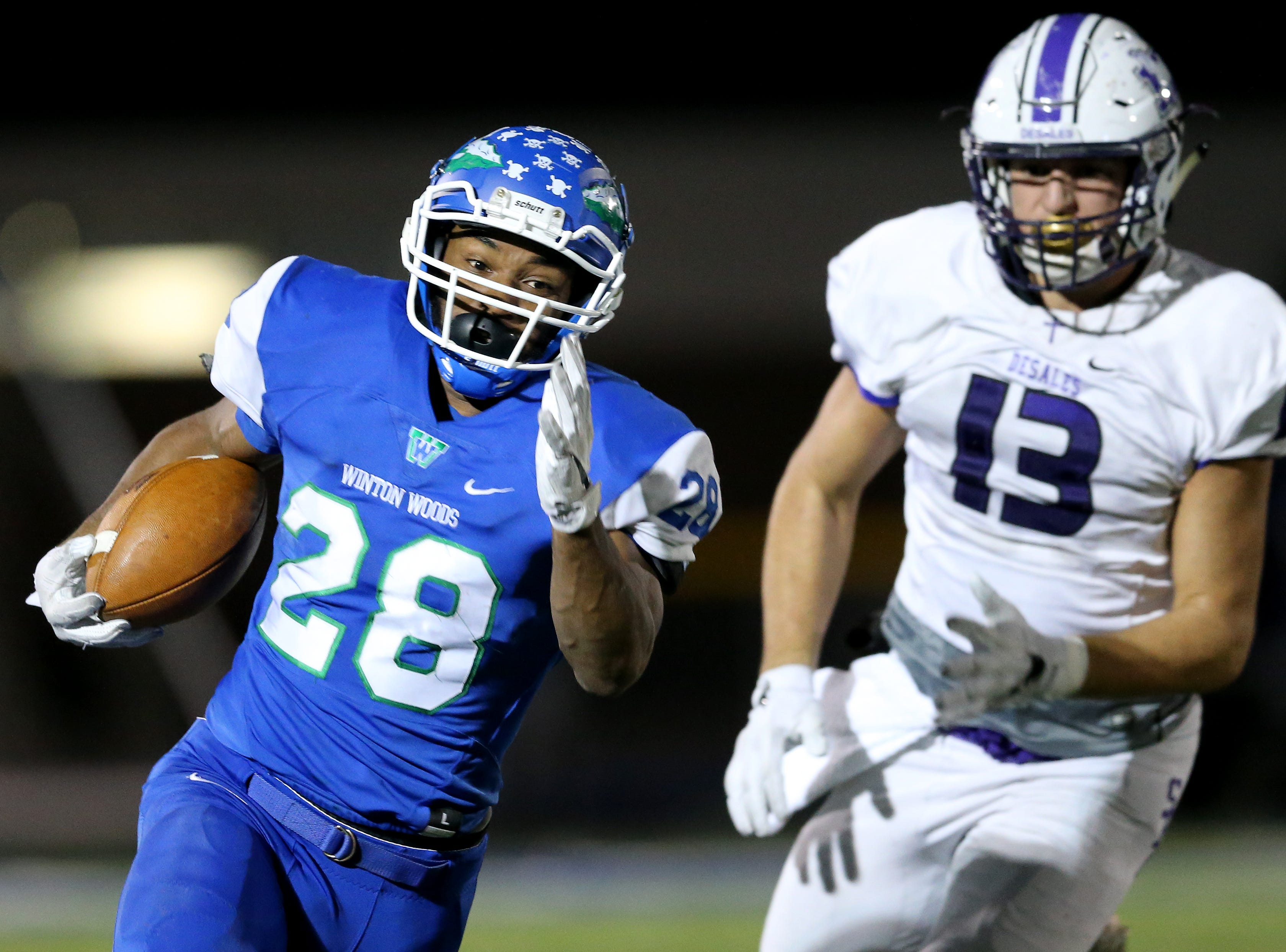 Winton Woods Warriors running back Miyan Williams (28) runs the ball in the second quarter during a high school football game between St. Francis de Sales and Winton Woods, Friday, Oct. 19, 2018, at Winton Woods High School in Forest Park, Ohio.