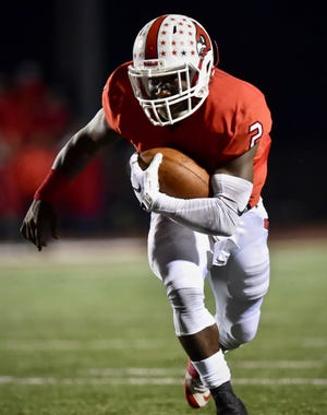 Colerain's Deante Smith-Moore scores a touchdown against Fairfield Friday, Oct. 19, 2018 at Colerain High School