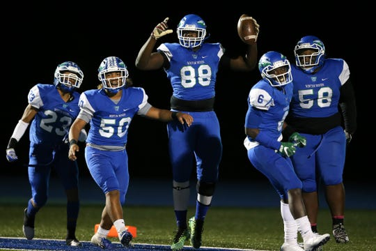 Winton Woods Warriors defensive lineman Anthony Booker (88) celebrates a fumble return for a touchdown, that was called back by a penalty, in the second quarter during a high school football game between St. Francis de Sales and Winton Woods, Friday, Oct. 19, 2018, at Winton Woods High School in Forest Park, Ohio.