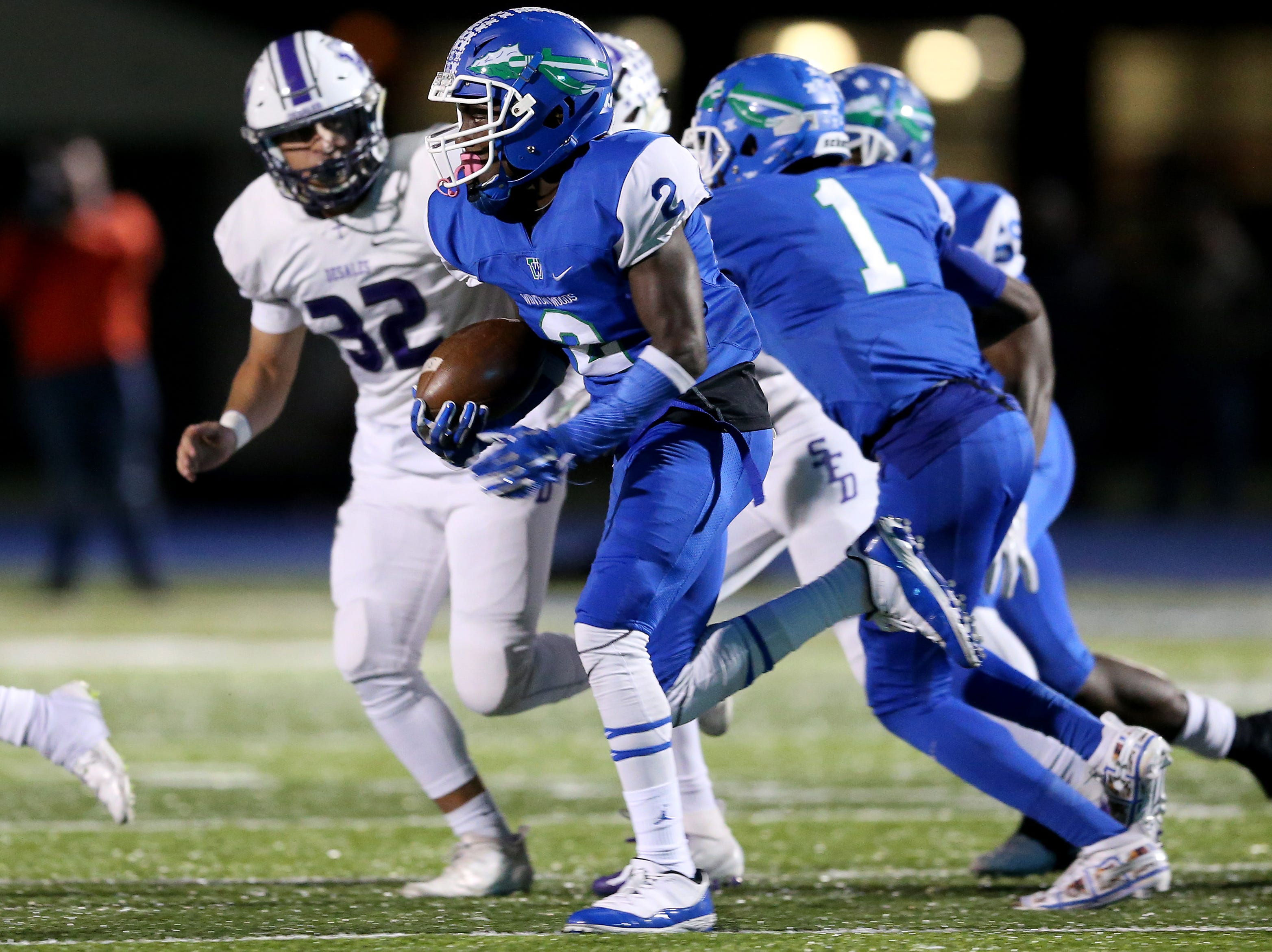Winton Woods Warriors wide receiver Rae'Quan Prince (2) returns a kick, which called back on a penalty, in the first quarter during a high school football game between St. Francis de Sales and Winton Woods, Friday, Oct. 19, 2018, at Winton Woods High School in Forest Park, Ohio.