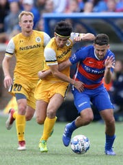FC Cincinnati midfielder Nazmi Albadawi (5) pushes the ball forward in the first half during a USL soccer playoff game between Nashville SC and FC Cincinnati, Saturday, Oct. 20, 2018, at Nippert Stadium in Cincinnati.