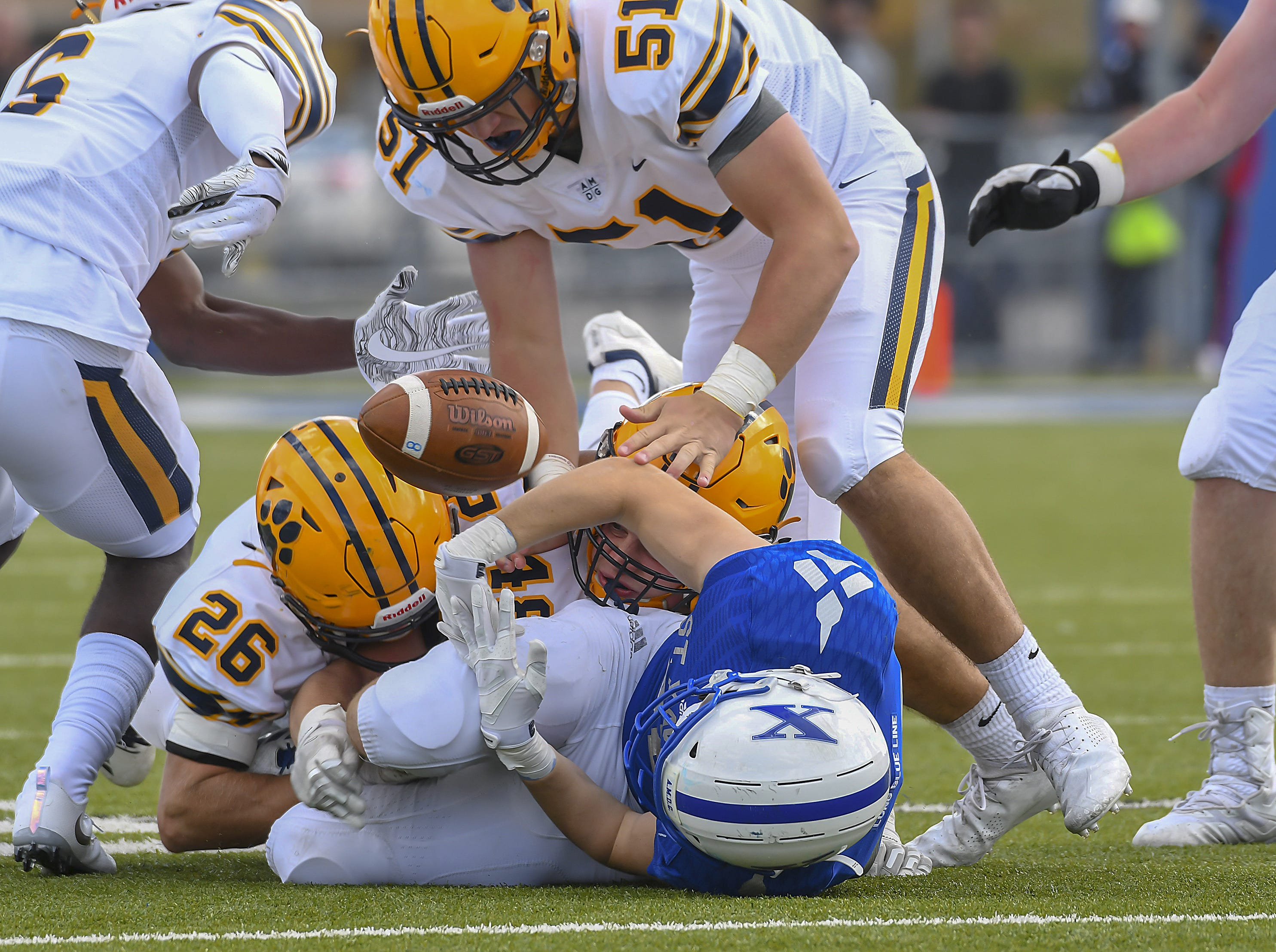 St. X receiver Patrick McIntyre fumbles the ball against St. Ignatius at St. Xavier High School, Saturday, October, 20 2018