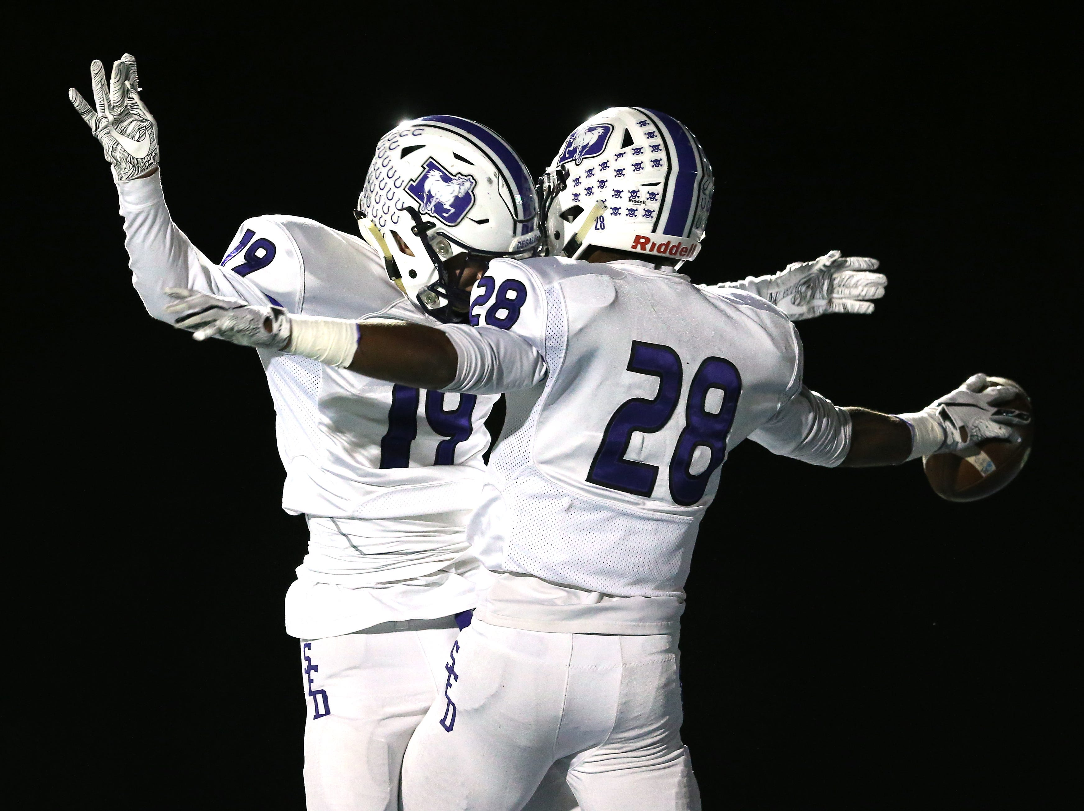 St. Francis de Sales Stallions running back Quintell Quinn (28), right, wide receiver Mason Rickens (19), left, celebrate a touchdown in the first quarter during a high school football game between St. Francis de Sales and Winton Woods, Friday, Oct. 19, 2018, at Winton Woods High School in Forest Park, Ohio.