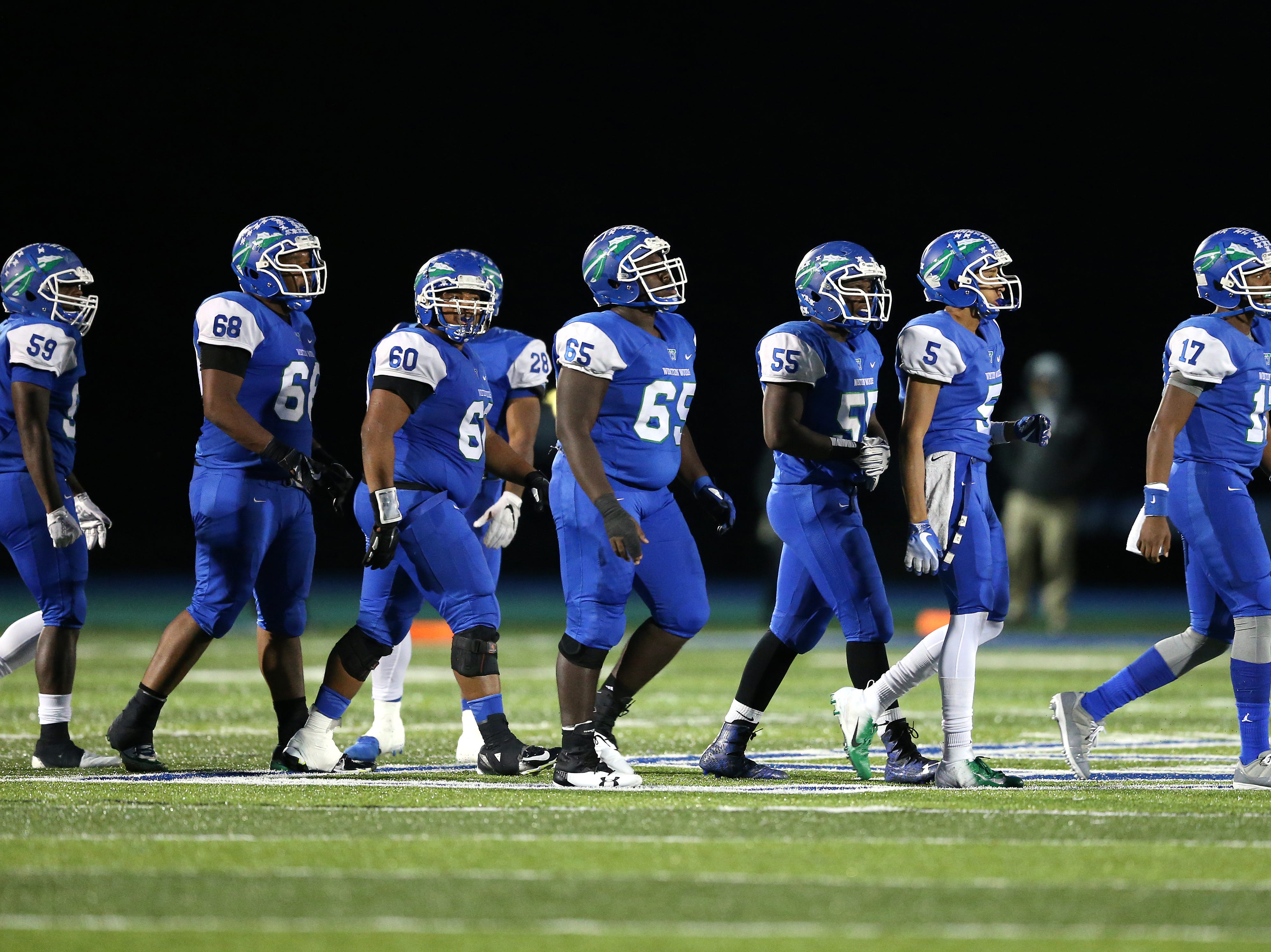 The Winton Woods Warriors offense looks toward the sideline in the first quarter during a high school football game between St. Francis de Sales and Winton Woods, Friday, Oct. 19, 2018, at Winton Woods High School in Forest Park, Ohio.