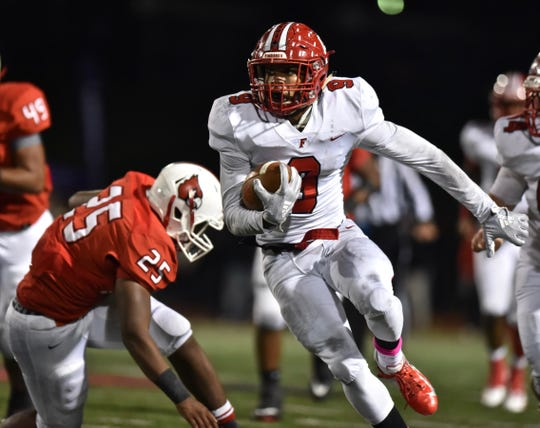 Jutahn Mcclain jukes a Colerain defender and gains a first down for the Fairfield Indians Friday, Oct. 19, 2018 at Colerain High School