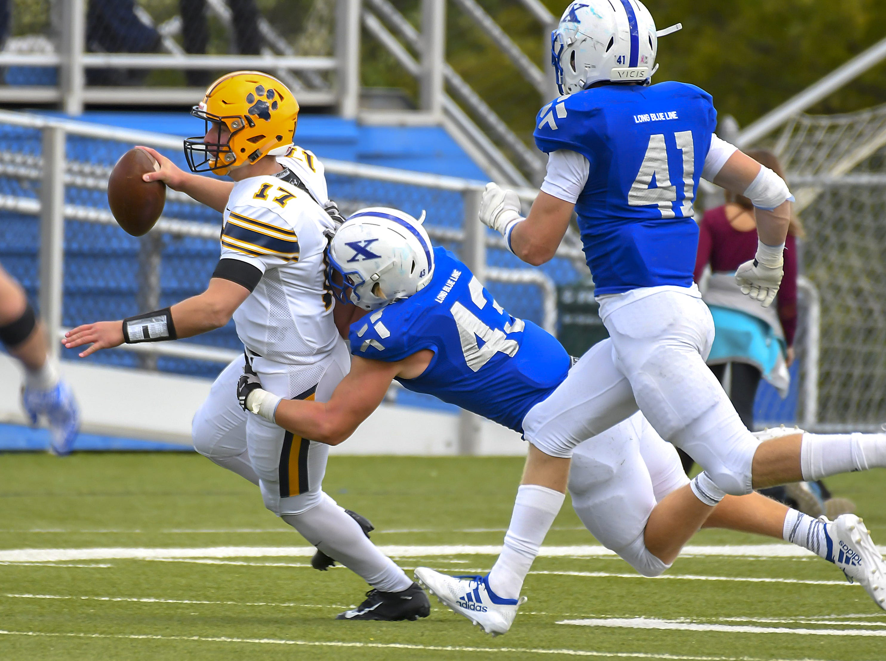 St X linebacker Nathan Arthur (43) is called for a horse collar tackle against St. Ignaius at St. Xavier High School, Saturday, October, 20 2018