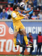 FC Cincinnati defender Forrest Lasso (3) goes up for a head challenge against Nashville SC forward Tucker Hume (12) in the first half during a USL soccer playoff game between Nashville SC and FC Cincinnati,Saturday, Oct. 20, 2018, at Nippert Stadium in Cincinnati.