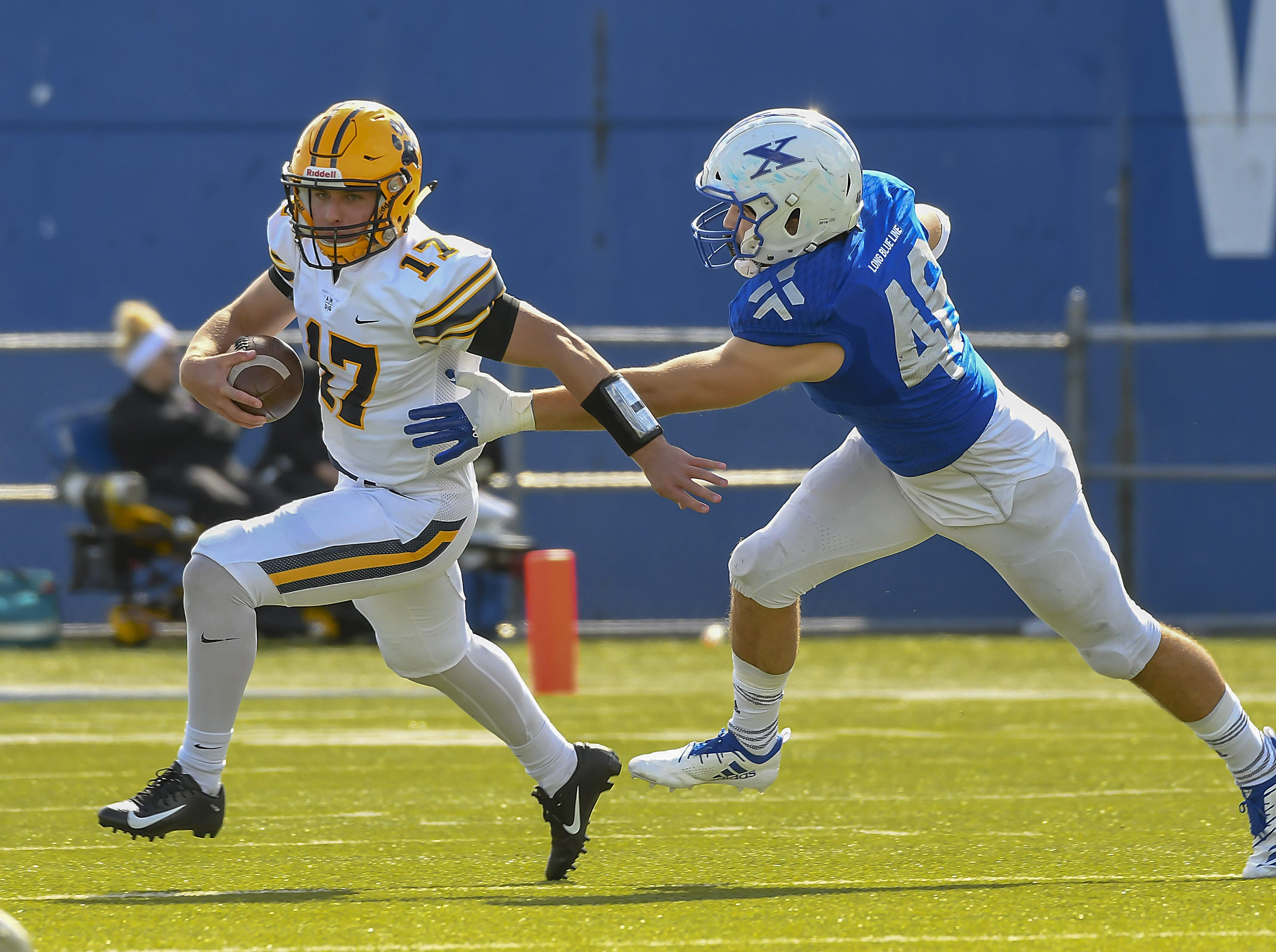 St I's quarterback Patrick Keane gets away from a St. X defender at St. Xavier High School, Saturday, October, 20 2018