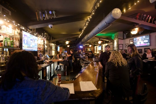 """Patrons stand around the bar at Mac's Tavern in Philadelphia on Friday, Oct. 19, 2018. Mac's Tavern is part owned by Actors from the Television show """"It's Always Sunny in Philadelphia""""."""