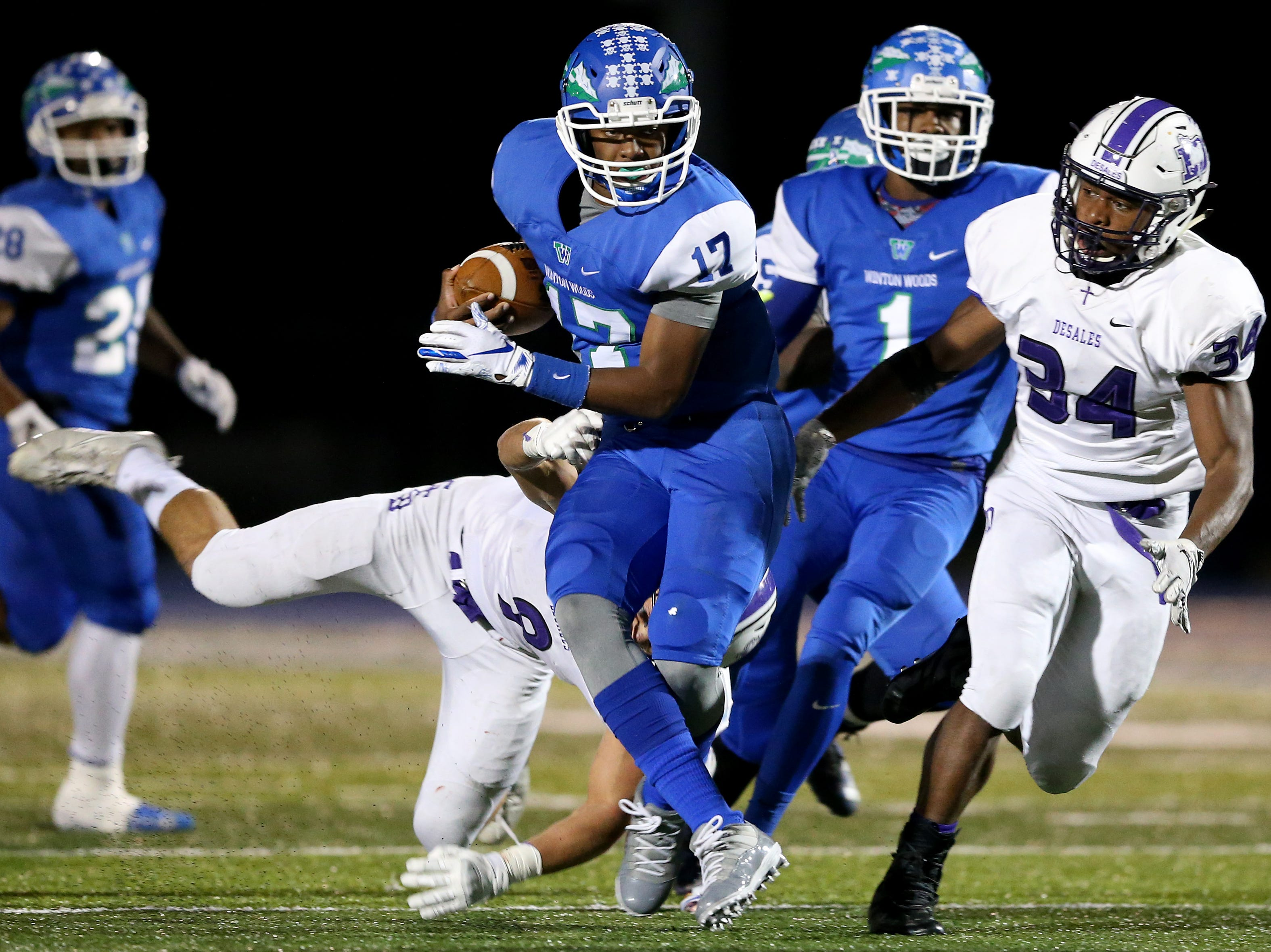 Winton Woods Warriors quarterback MiChale Wingfield (17) spins out of a tackle on a run in the second quarter during a high school football game between St. Francis de Sales and Winton Woods, Friday, Oct. 19, 2018, at Winton Woods High School in Forest Park, Ohio.