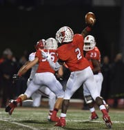 Colerain's Deante Smith-Moore drops back for a rare pass against Fairfield Friday, Oct. 19, 2018 at Colerain High School