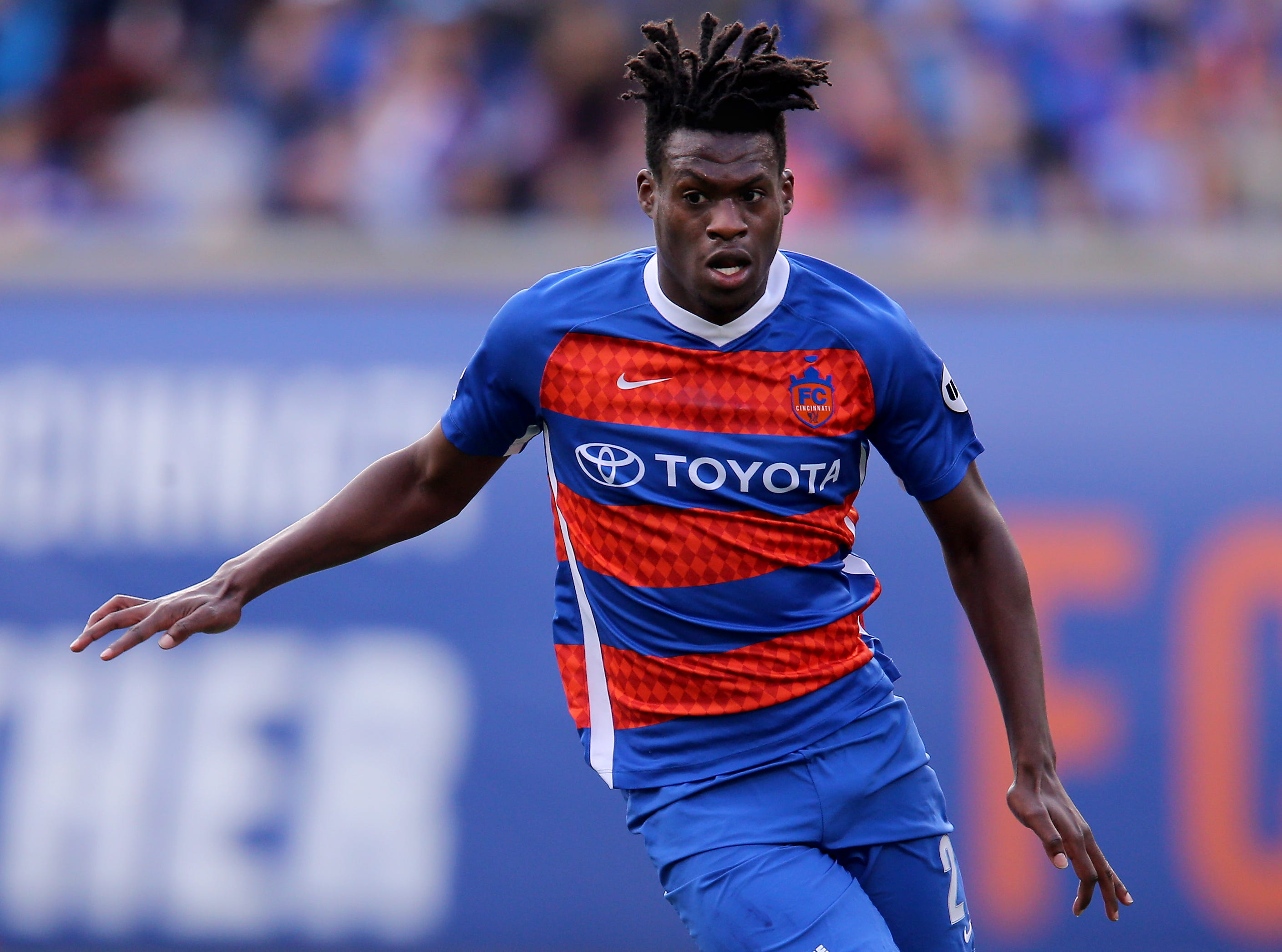 FC Cincinnati midfielder Fatai Alashe (27) dribbles the ball forward in the first half during a USL soccer playoff game between Nashville SC and FC Cincinnati,Saturday, Oct. 20, 2018, at Nippert Stadium in Cincinnati.