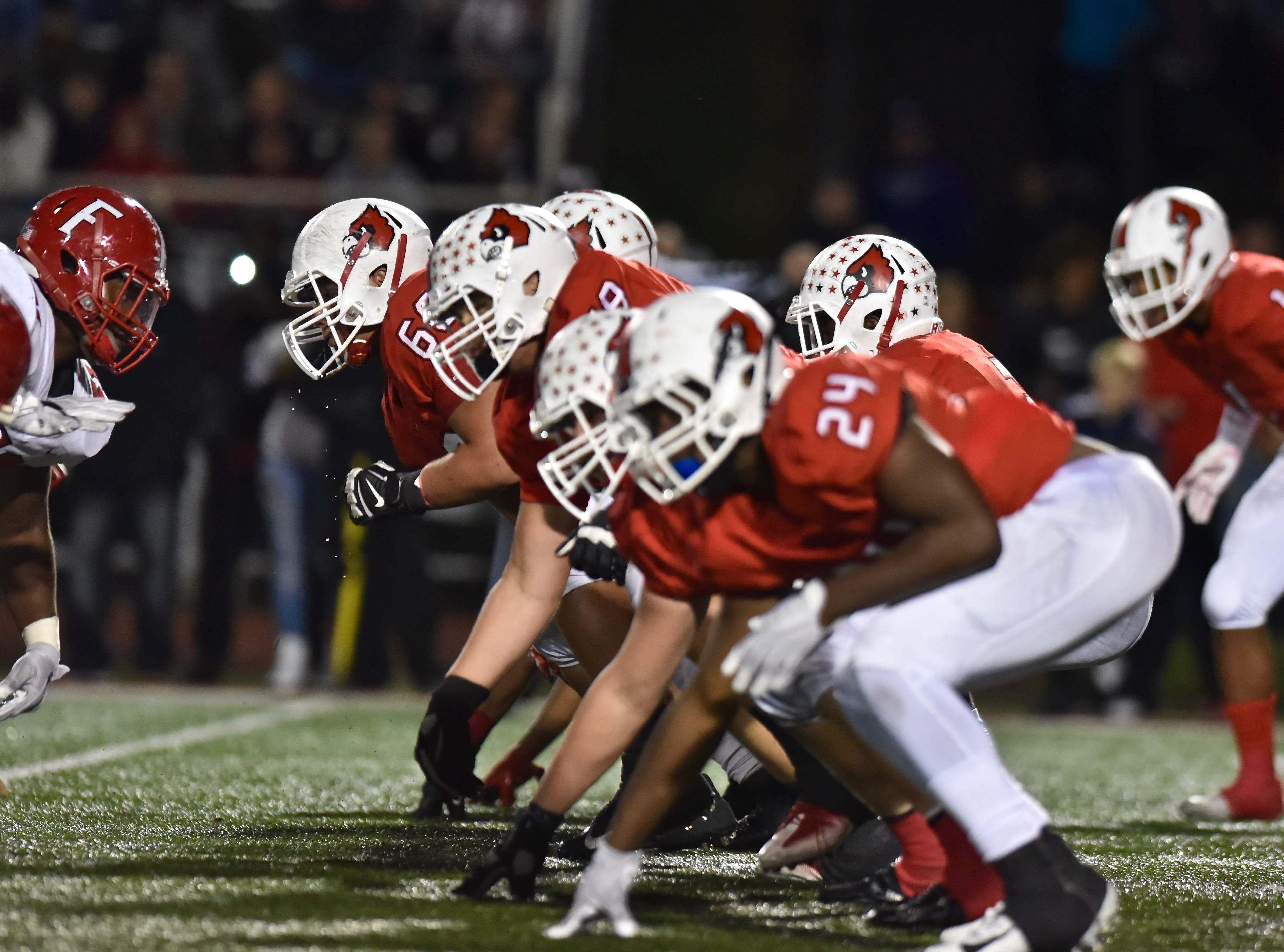 The Colerain Cardinals line up in their triple option formation against Fairfield Friday, Oct. 19, 2018 at Colerain High School