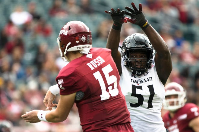Cincinnati Bearcats defensive end Kimoni Fitz (51) pressures Temple Owls quarterback Anthony Russo (15) during the NCAA football game between Cincinnati Bearcats and Temple Owls on Saturday, Oct. 20, 2018, at Lincoln Financial Field in Philadelphia, Penn.