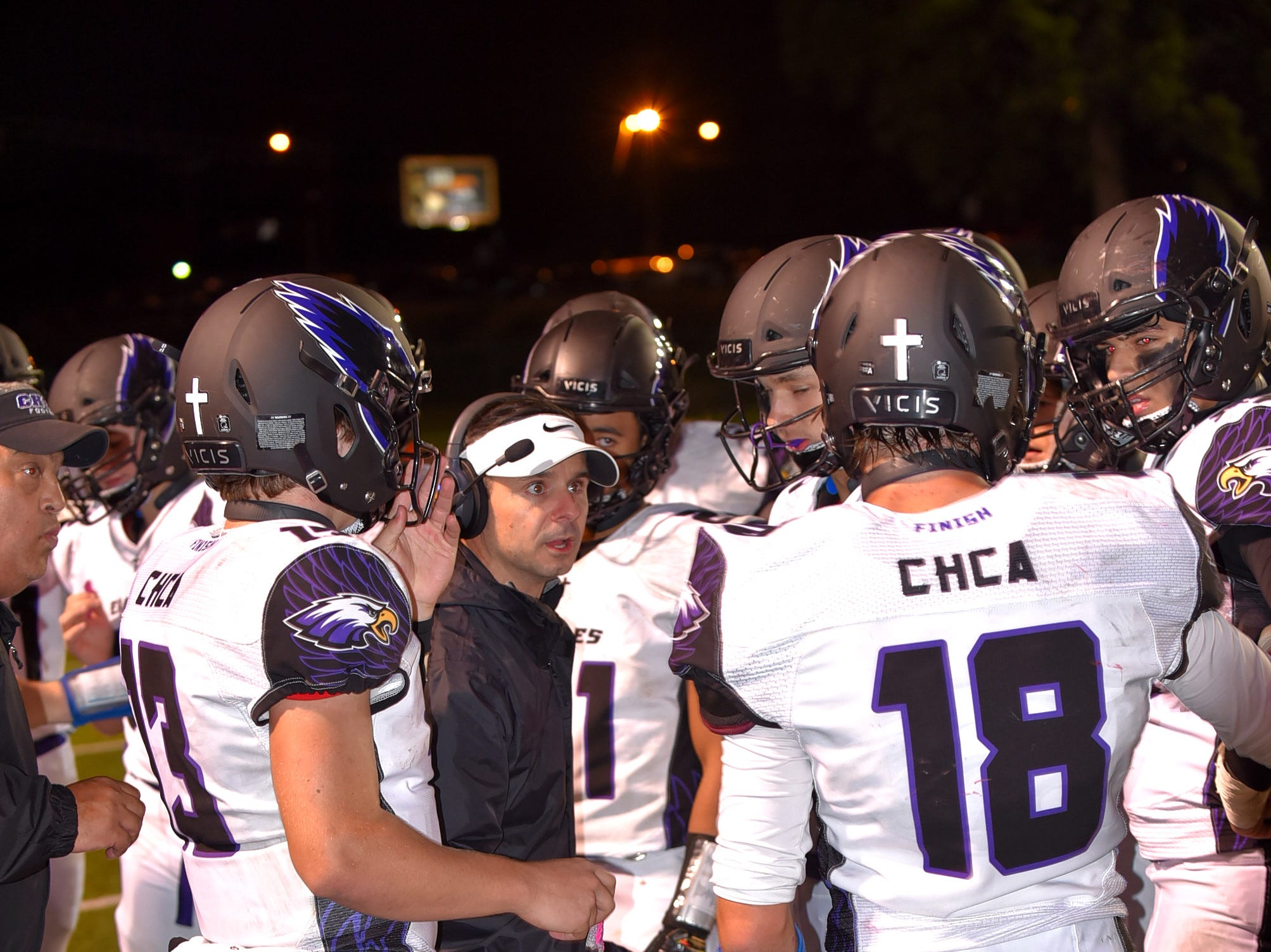 The CHCA offense reviews strategies during a timeout, October 19, 2018.