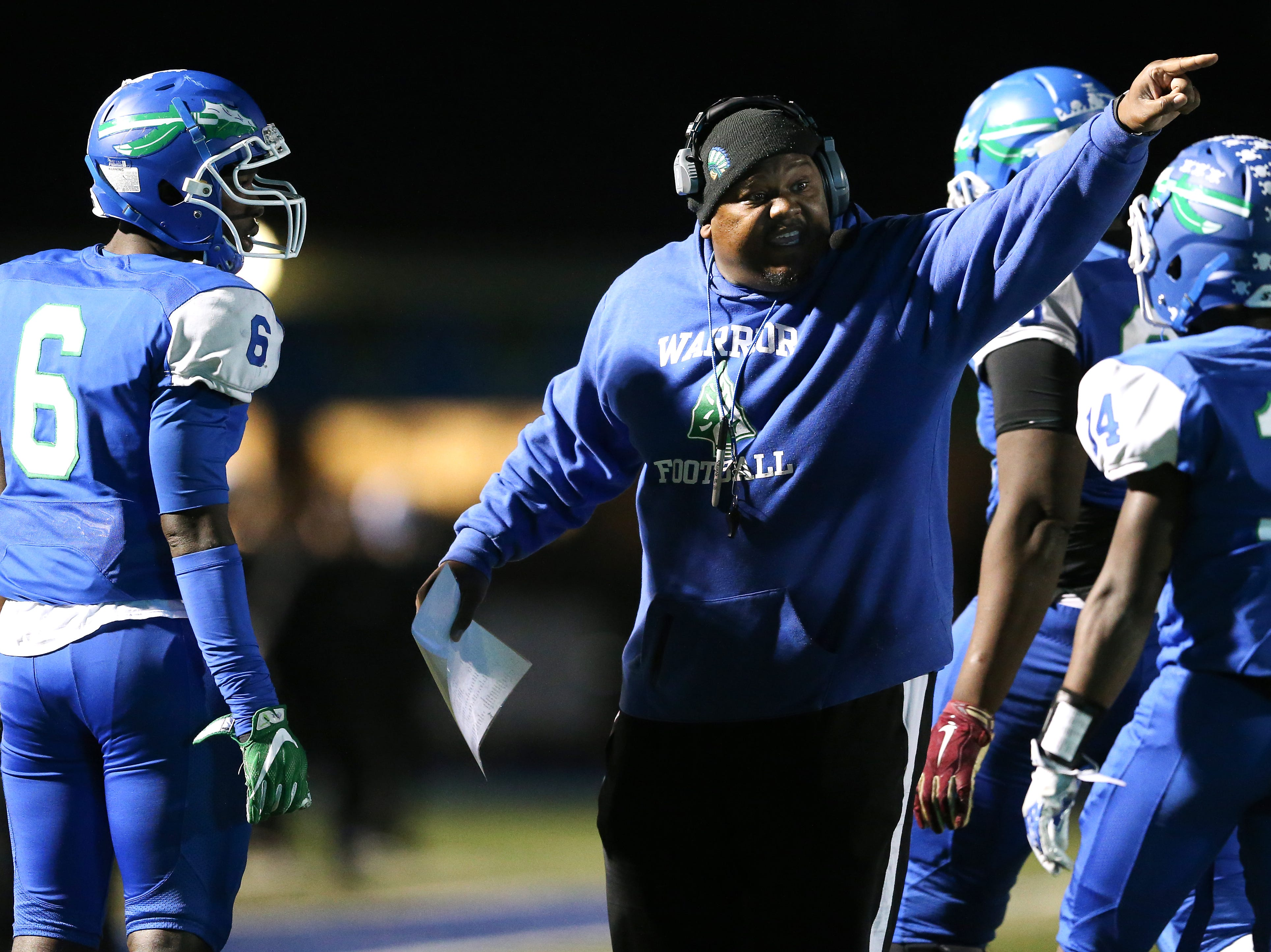 Winton Woods Warriors defensive line/linebackers coach Art Wilson instructs the team in the first quarter during a high school football game between St. Francis de Sales and Winton Woods, Friday, Oct. 19, 2018, at Winton Woods High School in Forest Park, Ohio.