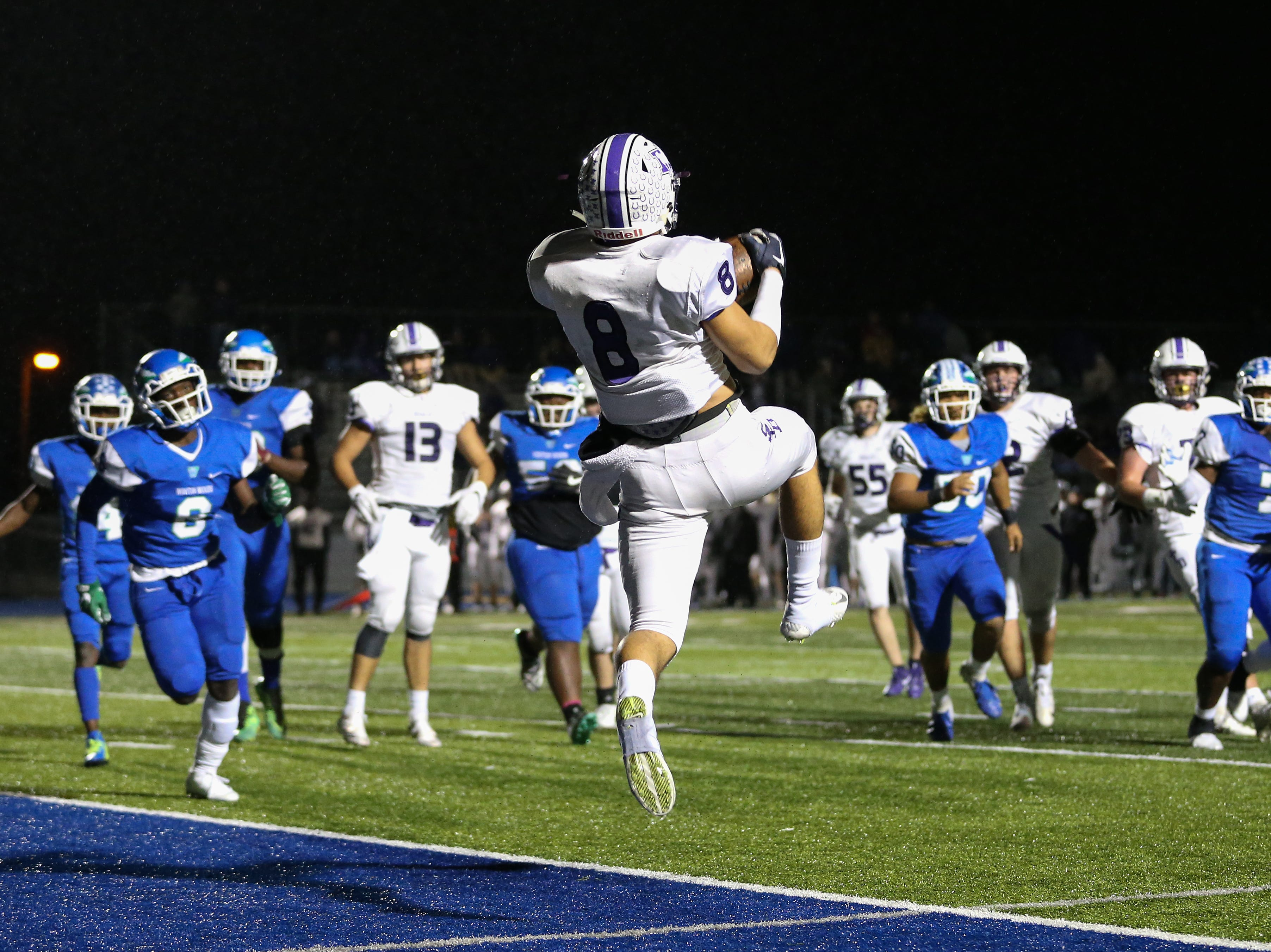 St. Francis de Sales Stallions wide receiver Anthony Sciarroni (8) scores a touchdown in the second quarter during a high school football game between St. Francis de Sales and Winton Woods, Friday, Oct. 19, 2018, at Winton Woods High School in Forest Park, Ohio.