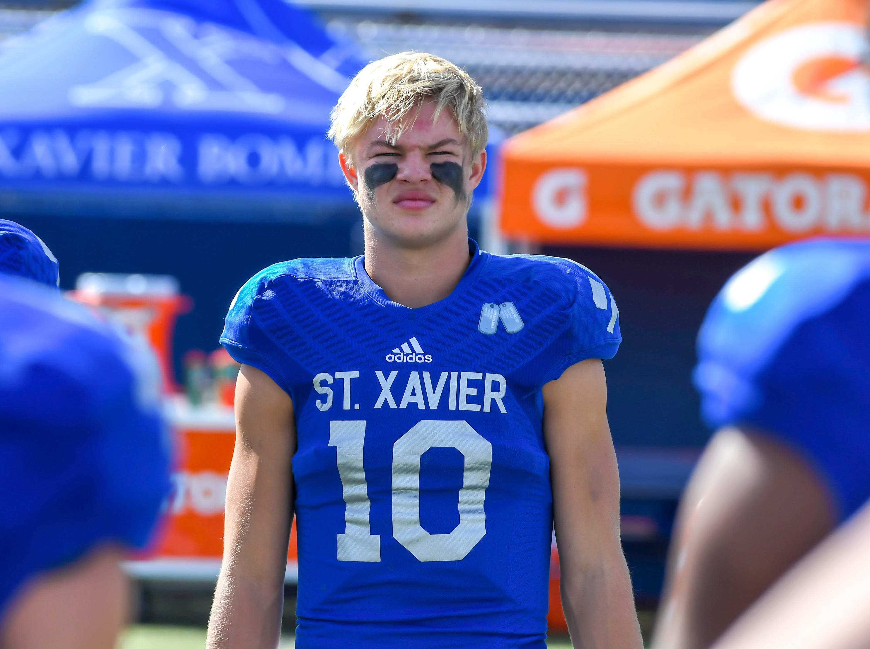 Jared Kreimer of St. X watches the coin flip before their game against Cleveland St. Ignatius at St. Xavier High School, Saturday, October, 20 2018