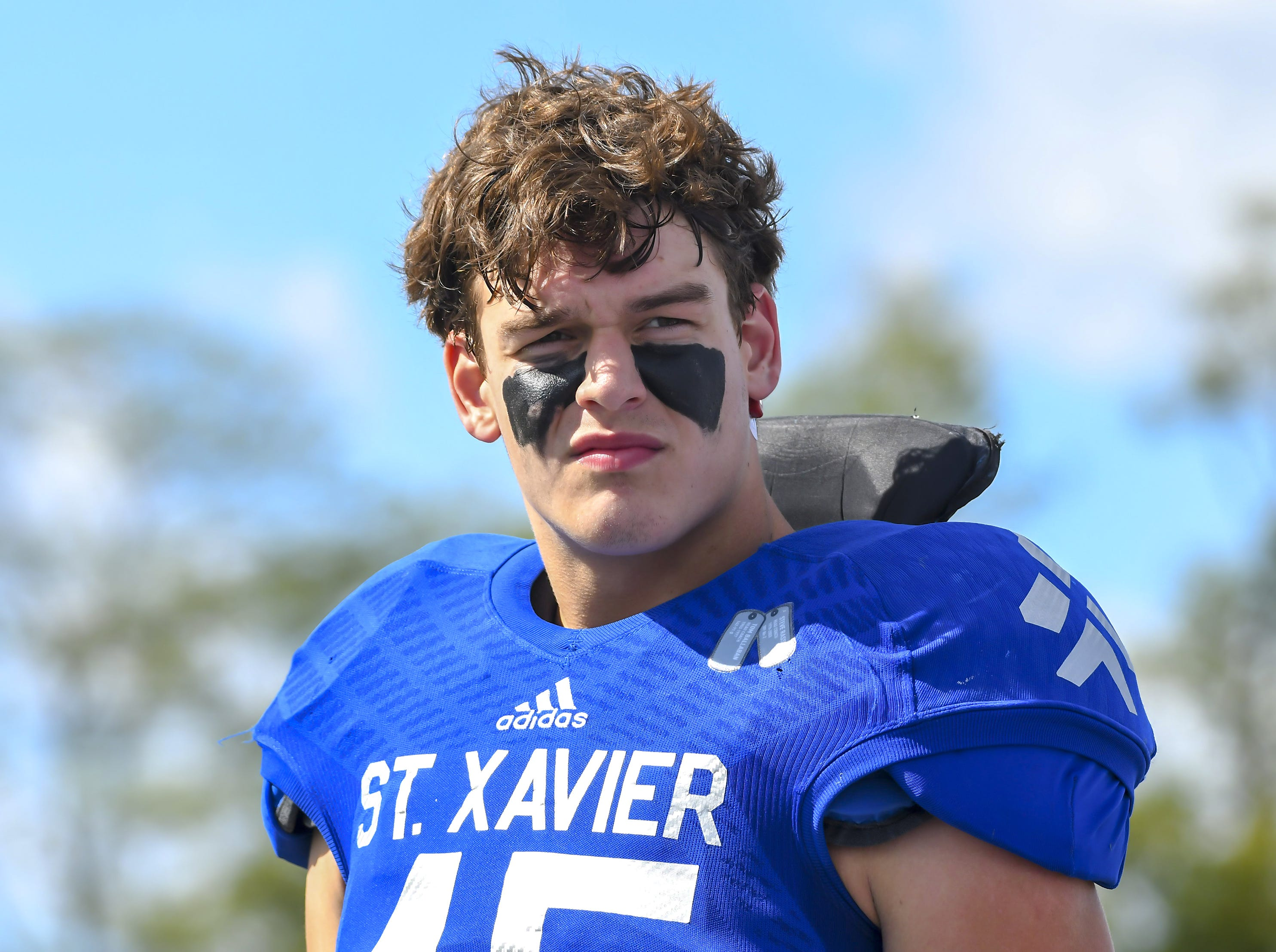 St. X linebacker Thomas Kiessling watches the coin flip before their game against Cleveland St. Ignatiusat St. Xavier High School, Saturday, October, 20 2018
