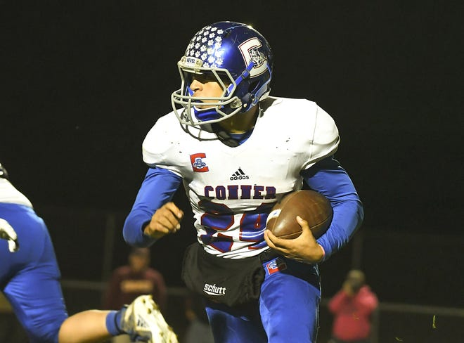 Conner running back Christian Webster runs the ball against Cooper in the Skyline Chili Crosstown Showdown at Cooper High School, Union, KY, Friday Oct. 19, 2018