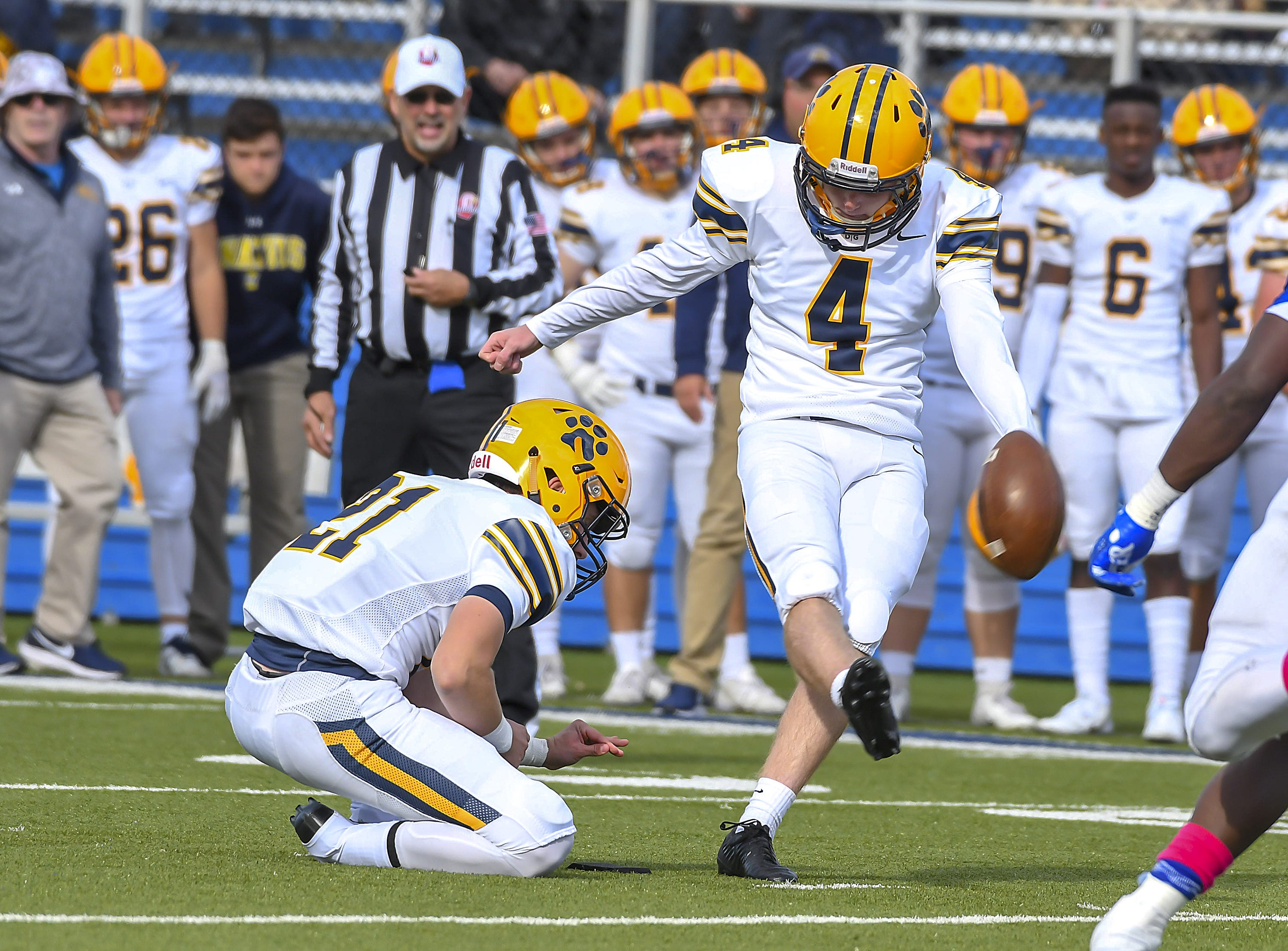 St. Ignatius kicker Rory McConville kicks the go ahead field goal in the fourth quareter against St. X at St. Xavier High School, Saturday, October, 20 2018