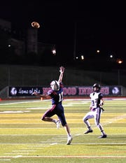 CHCA Quarterback Cole (Fisher) 13 launches a pass over the Norwood defense for an Eagles touchdown, October 19, 2018.