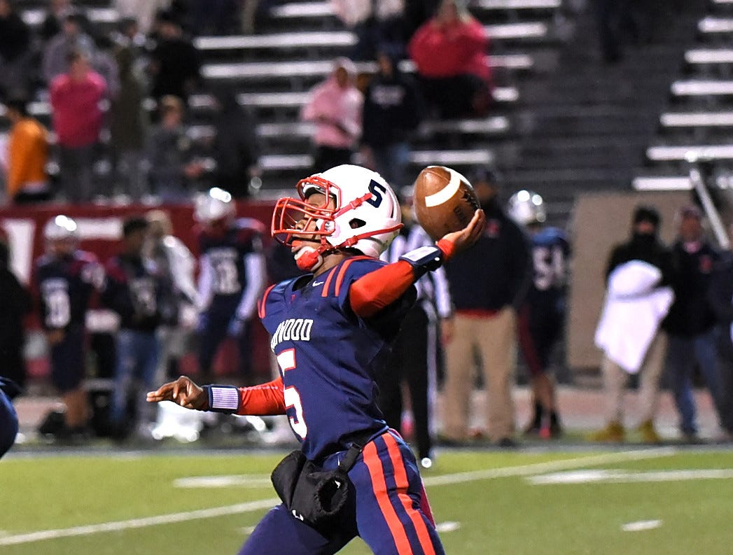 Norwood Quarterback Shawn Williams looks to complete a pass for the Indians, October 19, 2018.