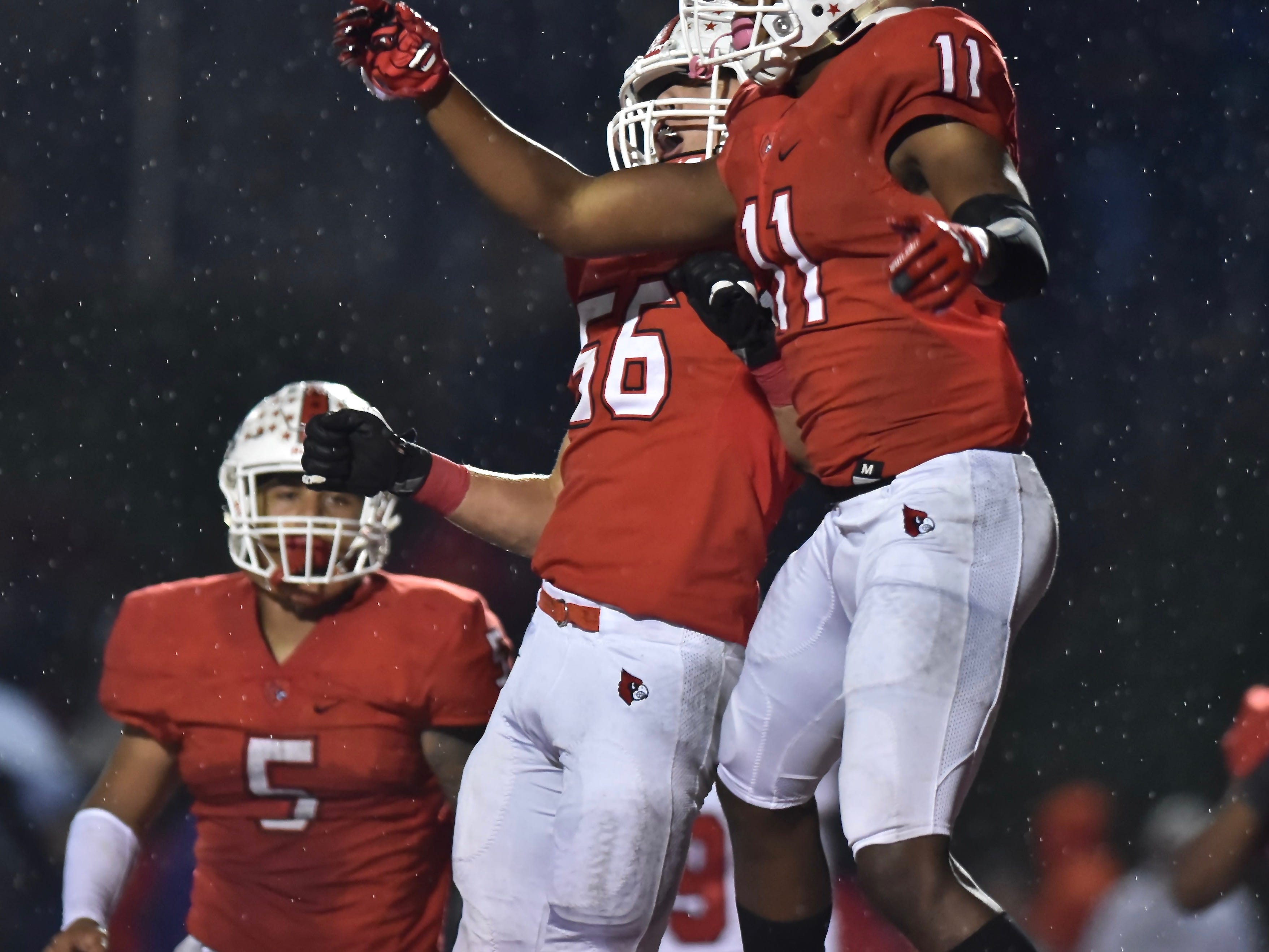 Colerain's Elijah Ford and Will Coleman celebrate against Fairfield Friday, Oct. 19, 2018 at Colerain High School