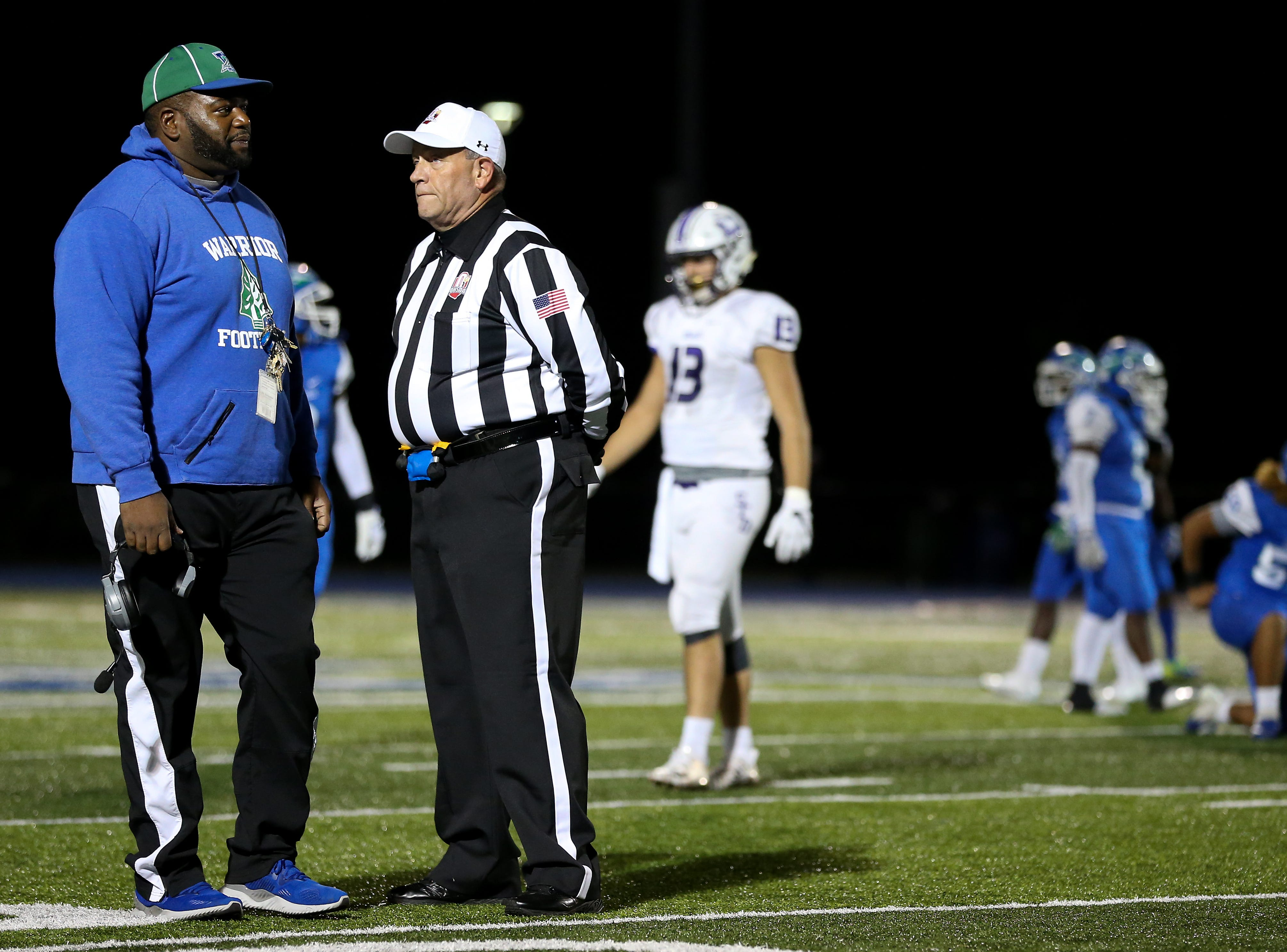 Winton Woods Warriors head coach Andre Parker, left, reacts after a discussion with the referee in the second quarter during a high school football game between St. Francis de Sales and Winton Woods, Friday, Oct. 19, 2018, at Winton Woods High School in Forest Park, Ohio.