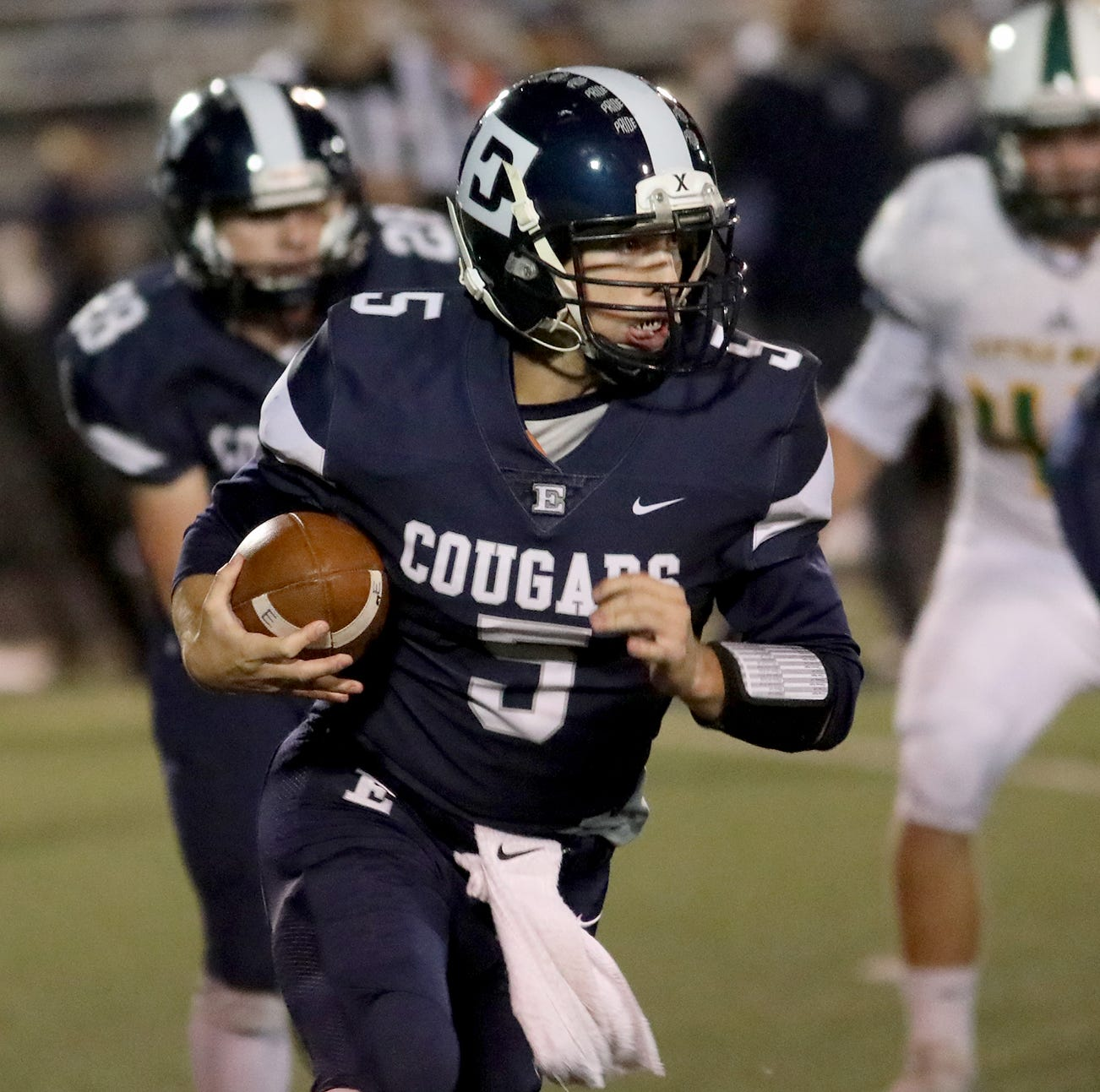 Edgewood quarterback Corbin Craft runs the ball During their football game against Little Miami, Friday, Oct. 19, 2018.