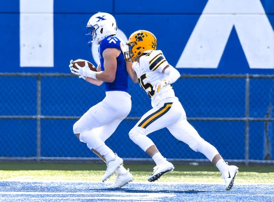 Liam Clifford of St. X catches a touchdown pass in the endzone against Cleveland St. Ignatius at St. Xavier High School, Saturday, October, 20 2018