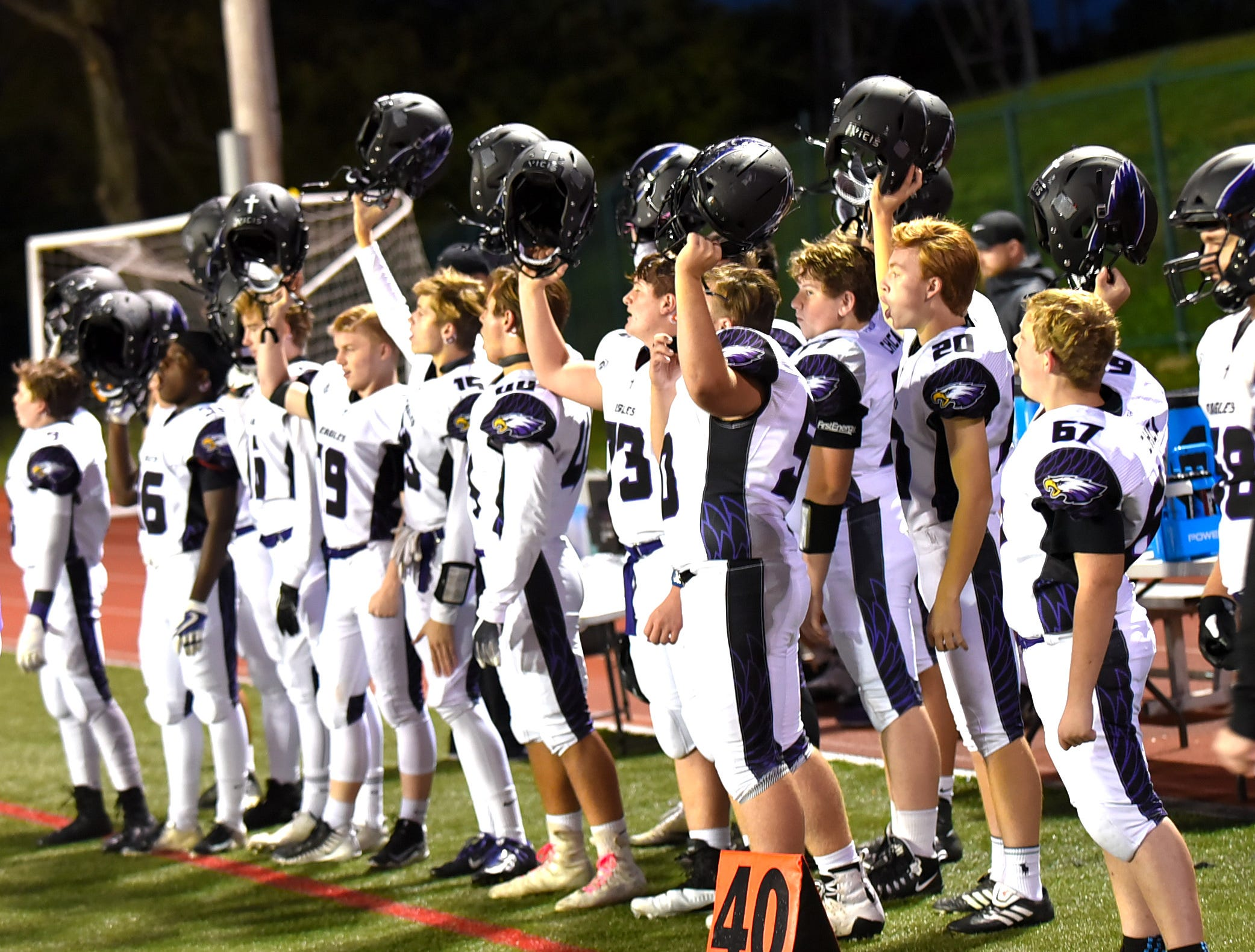 The CHCA Eagles raise their helmets for another kickoff after scoring a touchdown in their win over Norwood 50-0, October 19, 2018.
