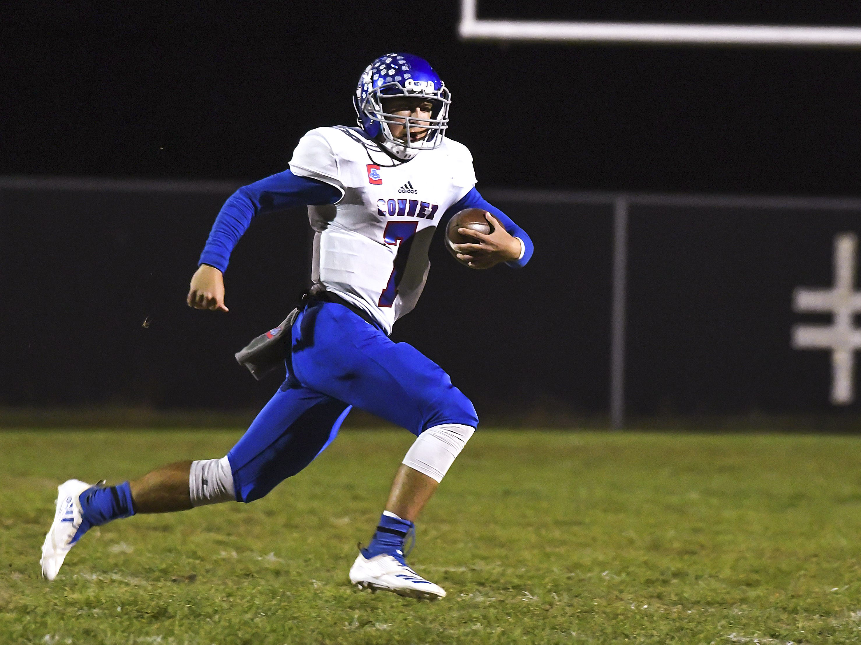 Jared Hicks of Conner runs the ball against Cooper in the Skyline Chili Crosstown Showdown at Cooper High School, Union, KY, Friday Oct. 19, 2018