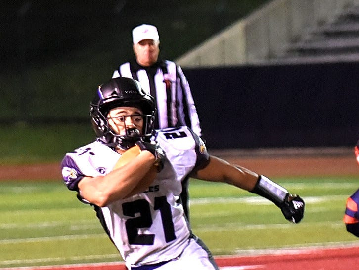 CHCA's Alex Bernard slices past the Norwood defense for a long gain, October 19, 2018.