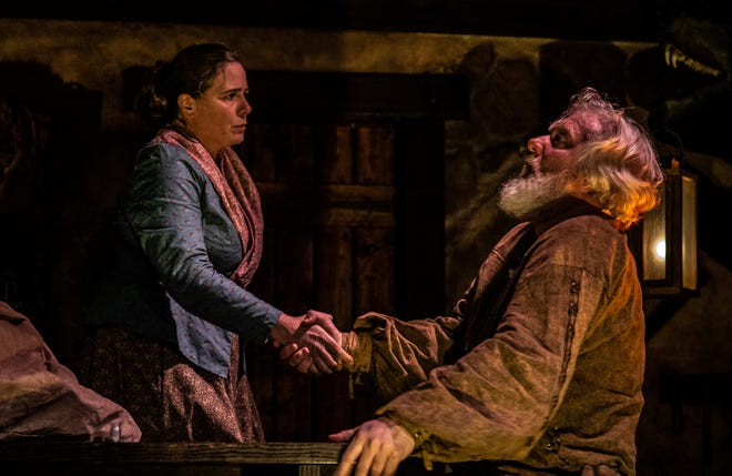 """Jennifer Joplin, left, and Jim Hopkins star in the Know Theatre's production of Joseph Zettelmaier's """"The Man-Beast."""" Joplin's character is rumored to be a witch of some sort. And here, she casts a spell on the unsuspecting hunter played by Hopkins. The show runs at the Know through Nov. 10."""