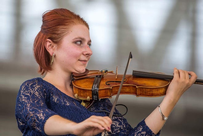 Kayla Waldron plays her beloved violin, which was stolen in early October from her car Downtown.