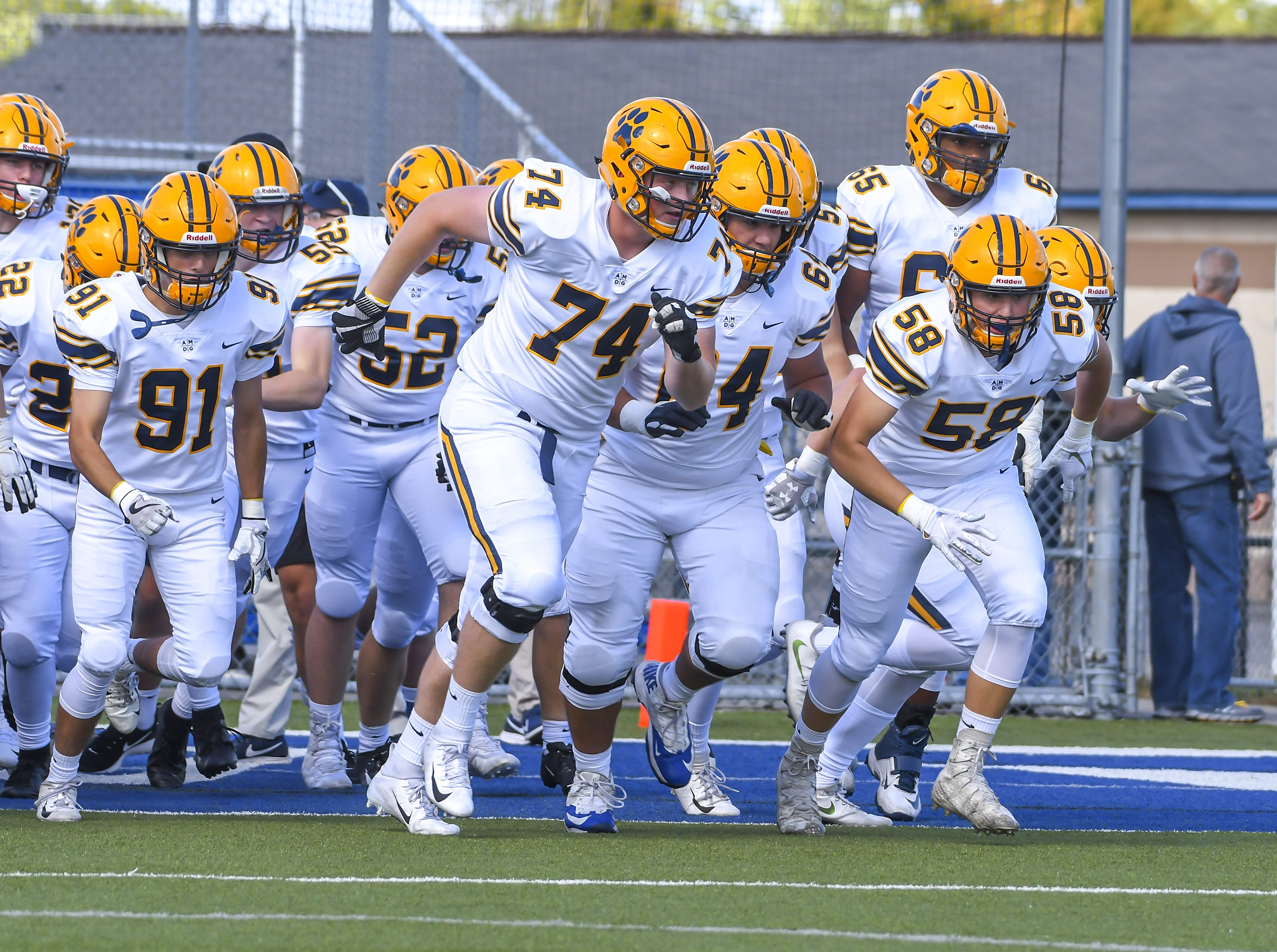 Cleveland St. Ignatius players run ontot the field before the game against St. x at St. Xavier High School, Saturday, October, 20 2018