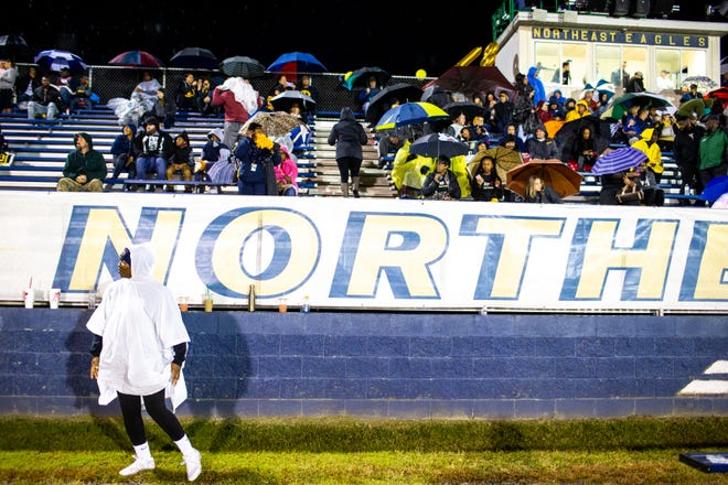 Northeast fans protect themselves from the rain before the game at Northeast High School Friday, Oct. 19, 2018, in Clarksville, Tenn.