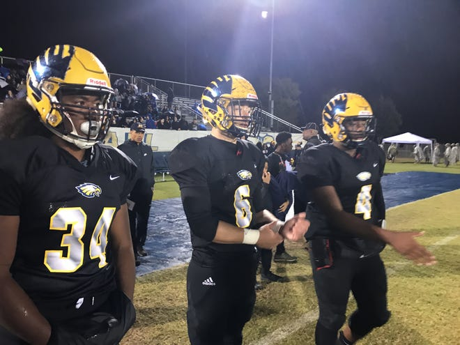 Northeast running back Tyrique Freeman (34) and quarterback Heath Williams (4) are wearing game jerseys of former Northeast standouts Travis Stephens (34) and Jalen Reeves-Maybin